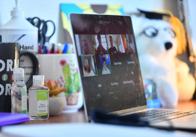 ALBUQUERQUE, NEW MEXICO - AUGUST 17:  Bottles of hand sanitizer sit next to a laptop showing a Zoom meeting as students begin classes amid the coronavirus (COVID-19) pandemic on the first day of the fall 2020 semester at the University of New Mexico on August 17, 2020 in Albuquerque, New Mexico. To help prevent the spread of COVID-19, the university has moved to a hybrid instruction model that includes a mixture of in-person and remote classes. According to the school, about 70 percent of classes are being taught online.  (Photo by Sam Wasson/Getty Images)