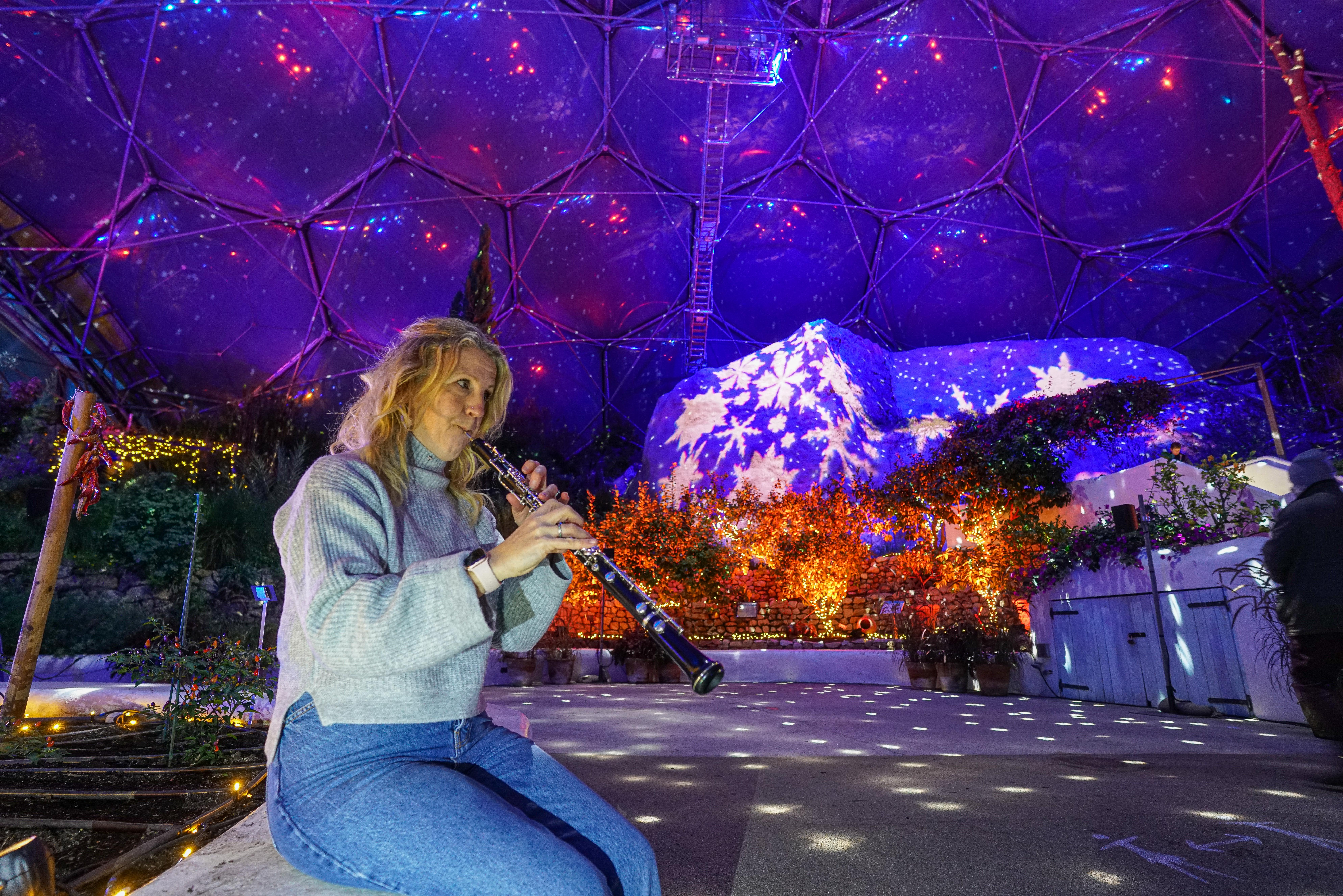 ST AUSTELL, ENGLAND - DECEMBER 03: Musician Tamsin Robinson rehearses for a live performance of festive music under the Christmas lights installation in the Mediterranean biome at the Eden Project on December 3, 2020 in St Austell, England. (Photo by Hugh Hastings/Getty Images)