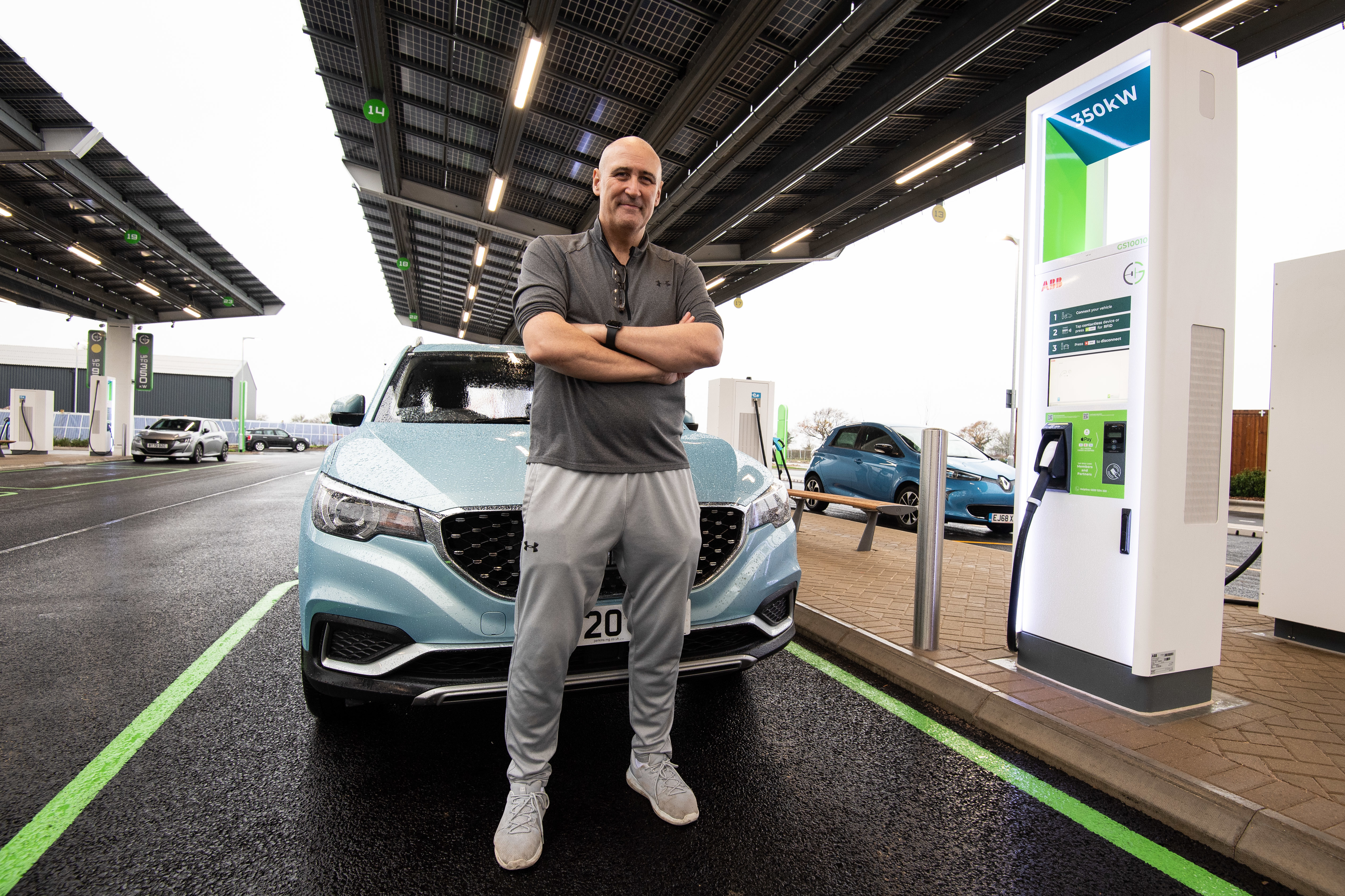 EDITORIAL USE ONLY Brian Cooke, from Essex is one of the first customers to charge his electric car at the newly opened GRIDSERVE, the UK's first Electric Forecourt, Essex.