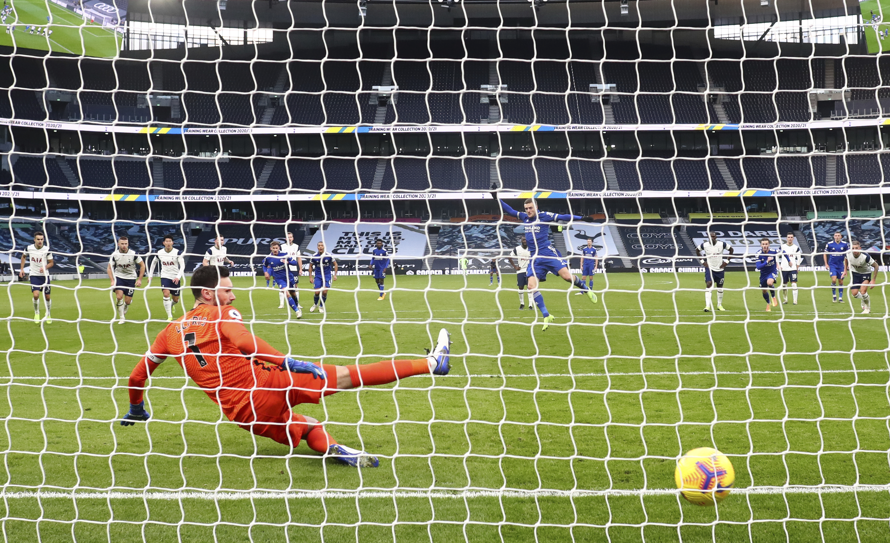 Leicester's Jamie Vardy shoots and scores from the penalty sport for the opening goal of the game during the English Premier League soccer match between Tottenham Hotspur and Leicester City at the White Hart Lane stadium in London, Sunday, Dec., 20 2020. (Julian Finney/ Pool via AP)