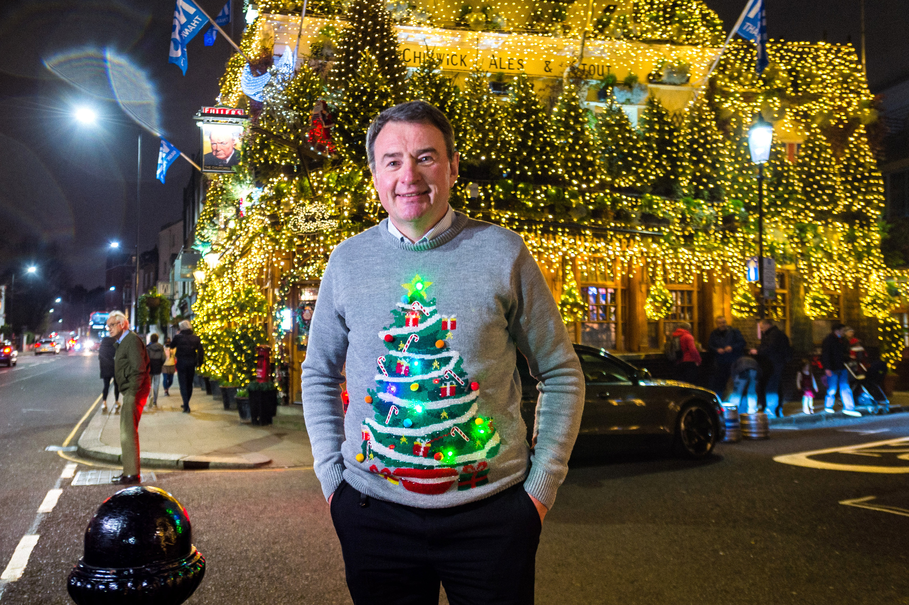 LONDON, ENGLAND - DECEMBER 02:  General Manager, James Keogh of The Churchill Arms poses outside his pub after turning on their 2020 Christmas lights on December 2, 2020 in London, England. Many Christmas events have been cancelled this year due to the Coronavirus Pandemic but London is festooned with Christmas Lights across the capital.  (Photo by Joseph Okpako/Getty Images)