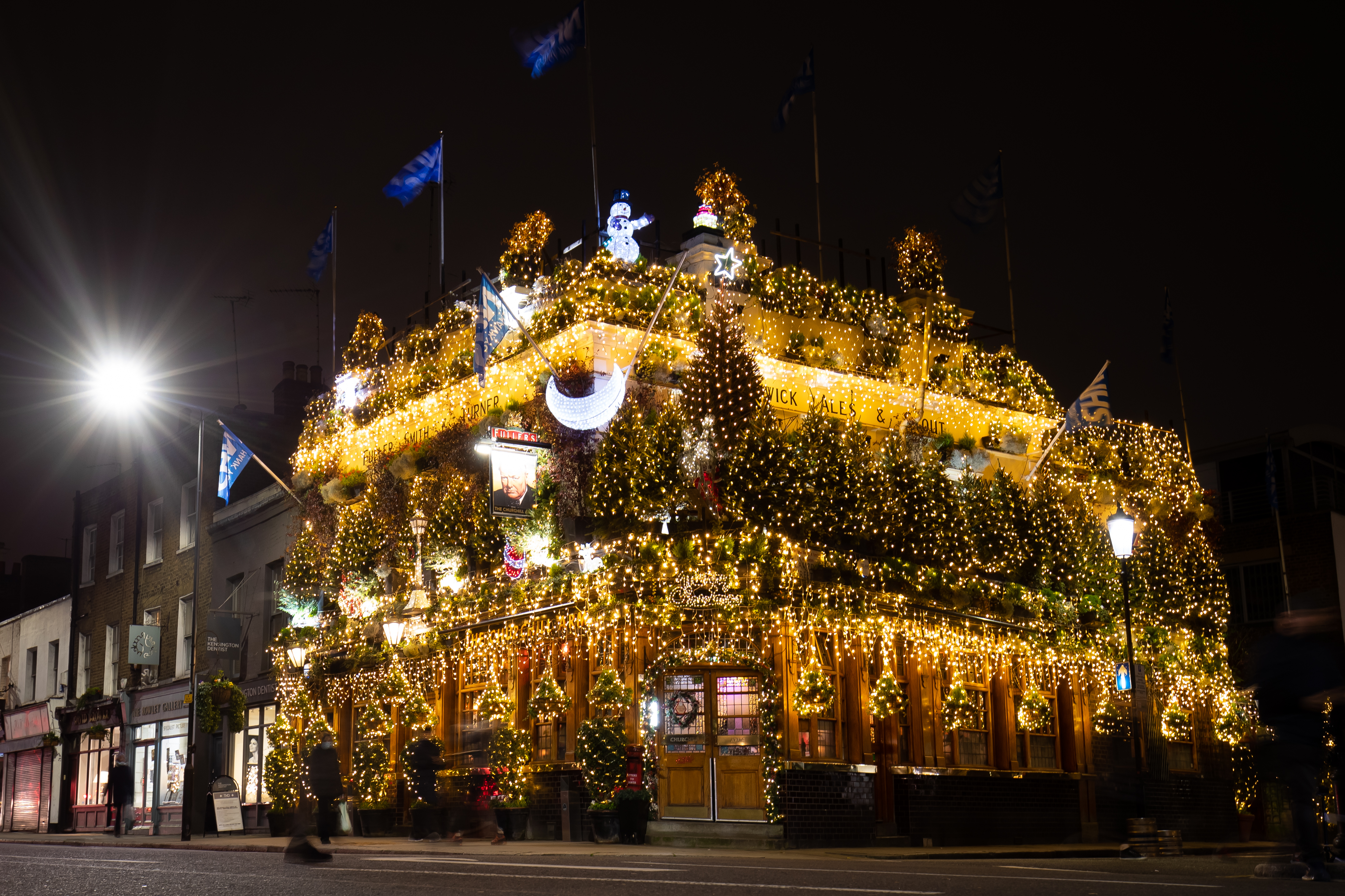 The Churchill Arms pub in London switches on its Christmas lights. (Photo by Aaron Chown/PA Images via Getty Images)