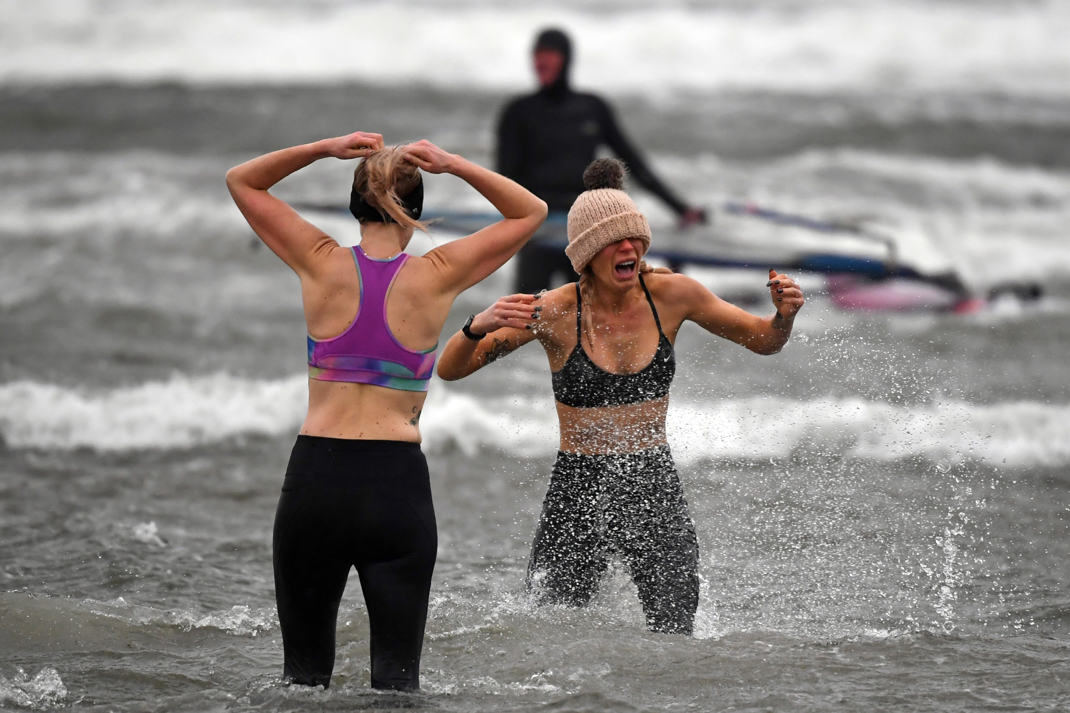 Members of the public take to the water at Barassie Beach in Troon, on the west coast of Scotland on Boxing Day, December 26, 2020 as Storm Bella brings rain and high winds to the UK. (Photo by Andy Buchanan / AFP) (Photo by ANDY BUCHANAN/AFP via Getty Images)