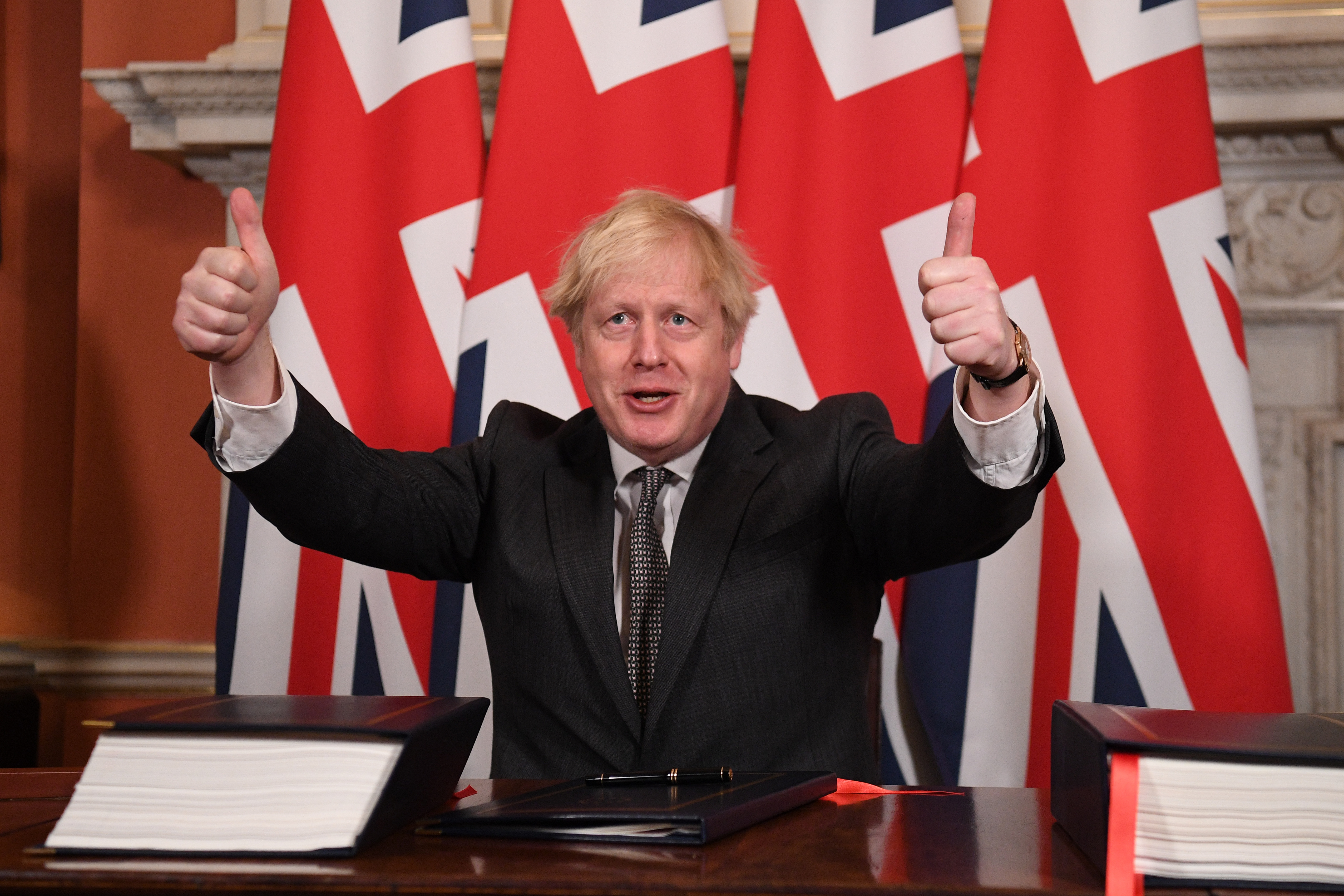 Prime Minister Boris Johnson gives a thumbs up gesture after signing the EU-UK Trade and Cooperation Agreement at 10 Downing Street, Westminster.