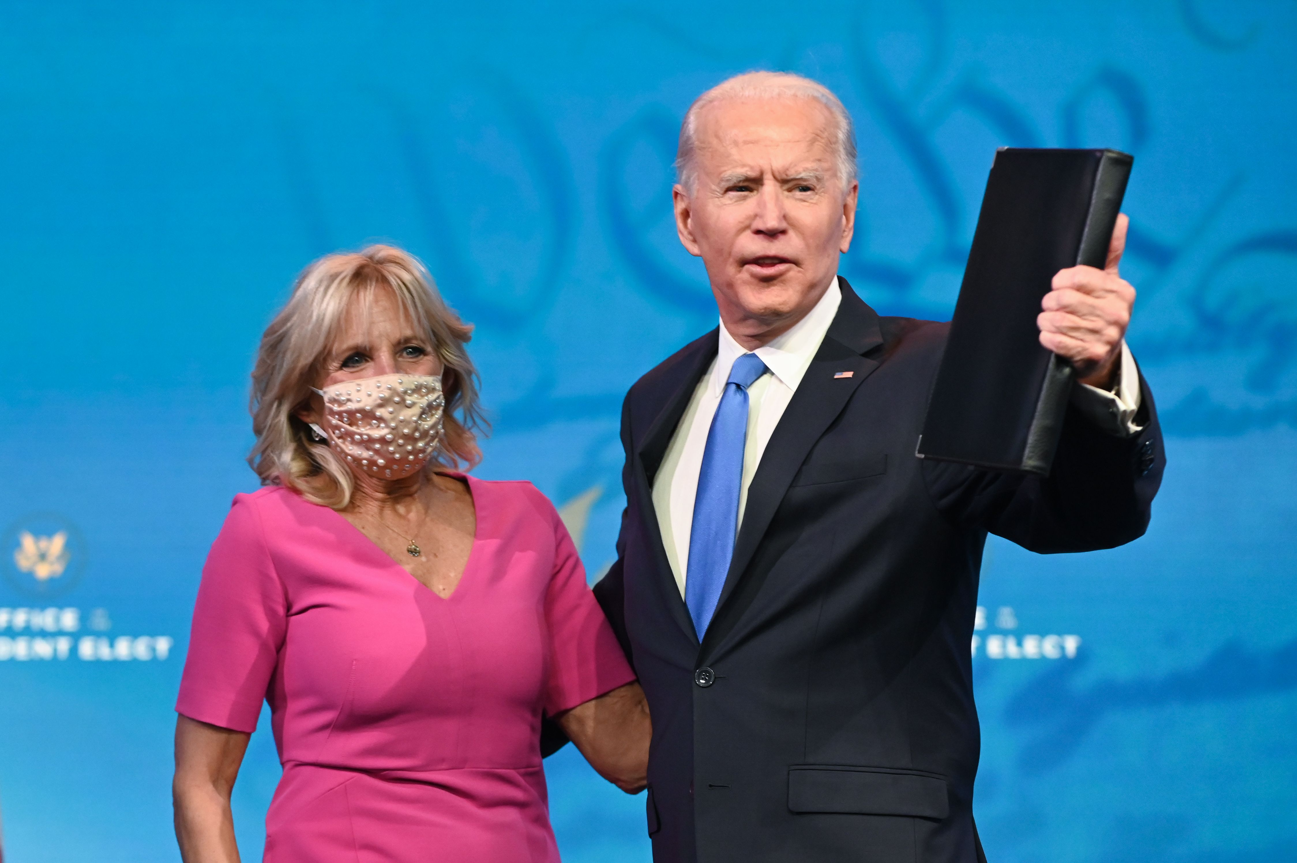 US President-elect Joe Biden arrives with wife Jill Biden to deliver remarks on the Electoral college certification at the Queen Theatre in Wilmington, Delaware on December 14, 2020. (Photo by ROBERTO SCHMIDT / AFP) (Photo by ROBERTO SCHMIDT/AFP via Getty Images)