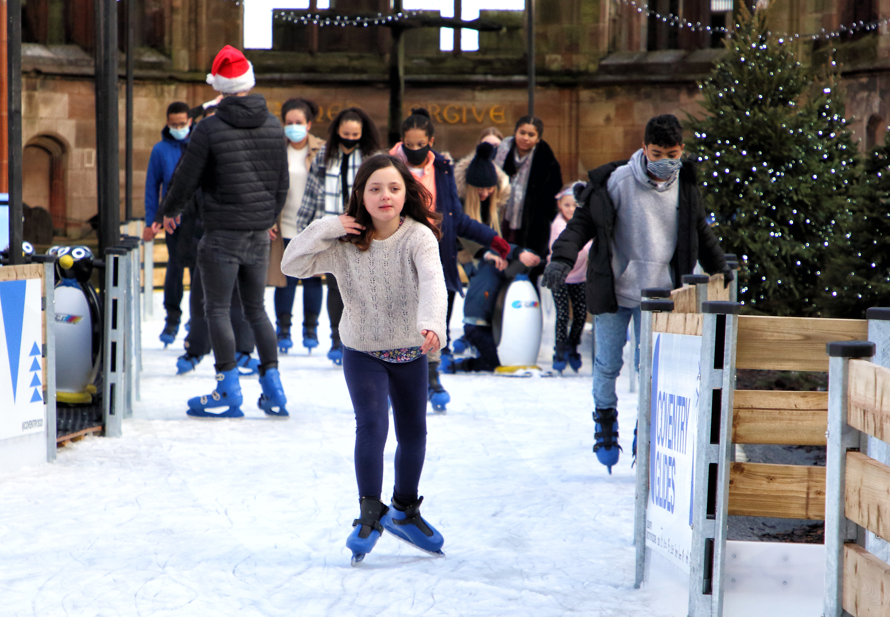 Skaters on the new Coventry Glides Ice skating rink. Coventry Glides will go ahead under Tier 3 Covid-19 restrictions, in line with national regulations. It means that, up until the possible revision of the Tier system on 16 December, the event will now only admit audiences from Coventry, Warwickshire, and Solihull. People from outside of these areas who have already booked tickets for dates before 16 December will be contacted for a full refund. (Photo by Keith Mayhew / SOPA Images/Sipa USA)