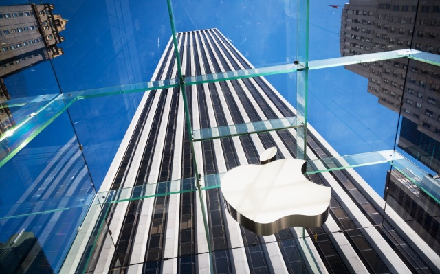 """New York, United States - May 12, 2012: Glass entrance of the Apple Store at 5th Avenue near Central Park with huge Apple Logo."""