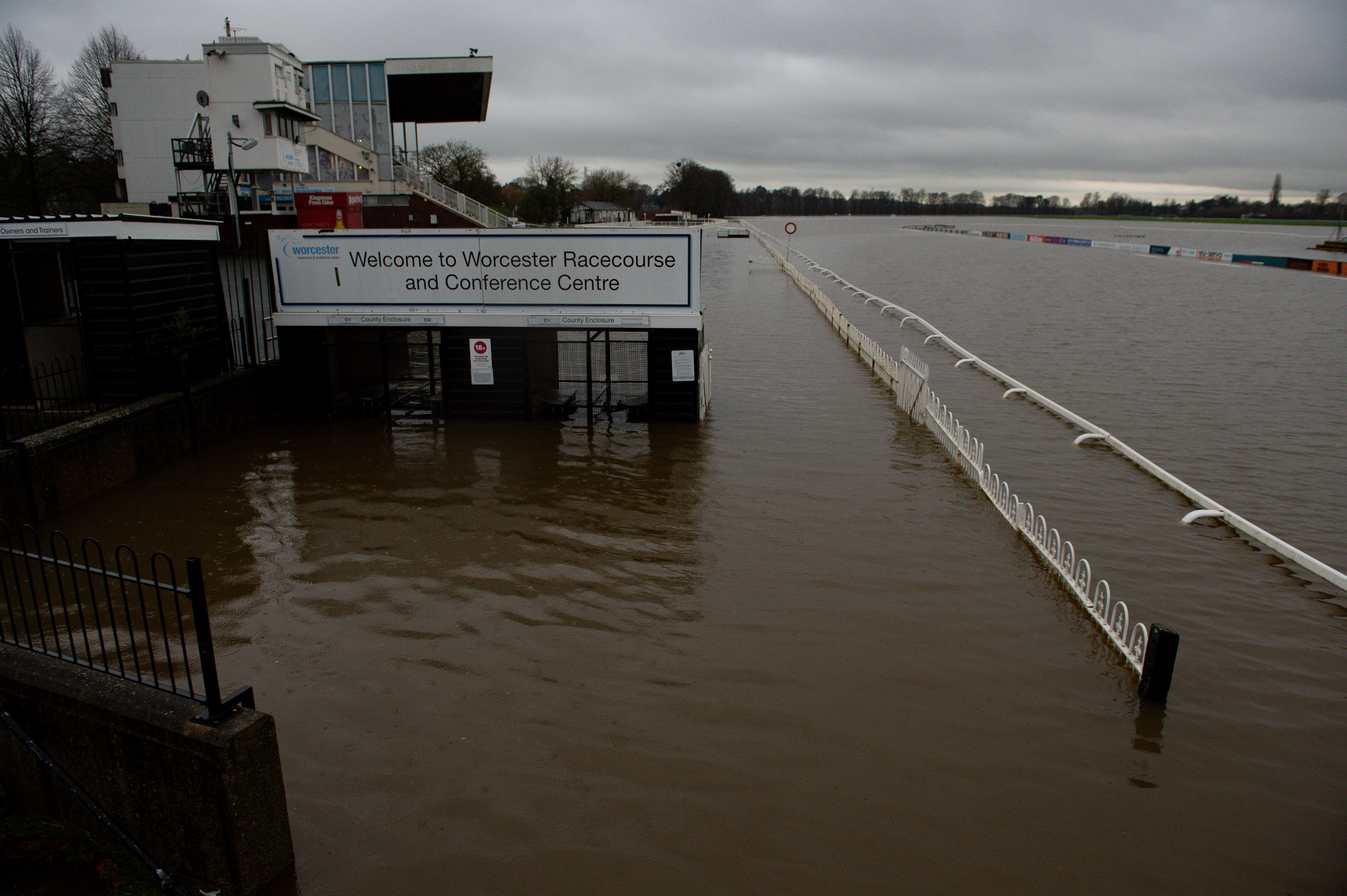 Flood water covers the racecourse at Worcester after heavy rain.