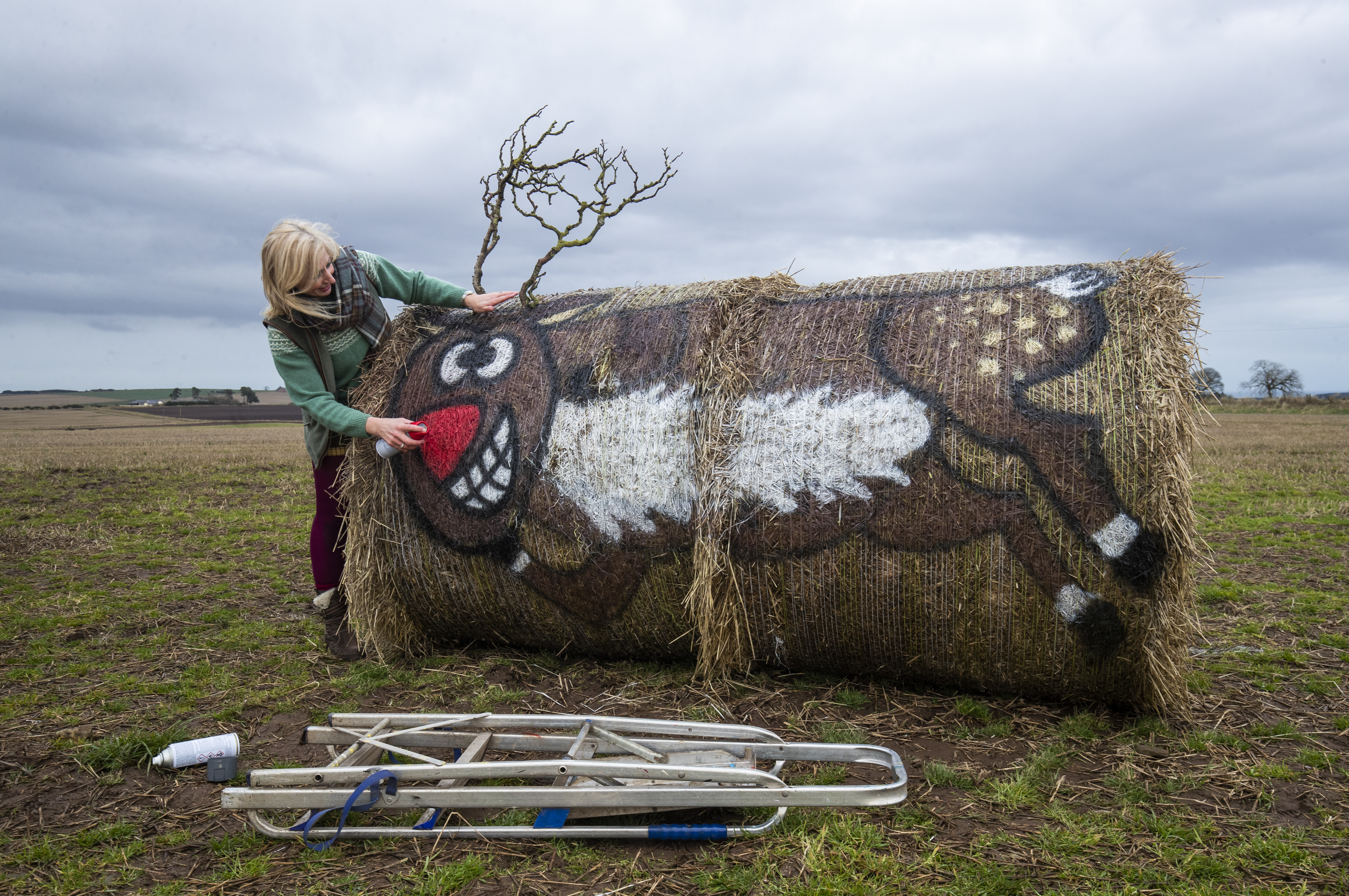 Farmer and artist Fleur Baxter with the Christmas character artworks she has created using hay bales on her farm in Carmyllie, Angus. Fleur, who has been nicknamed 'Balesy' by locals, allows members of the public to visit the bales in return for donations to the local food bank. (Photo by Jane Barlow/PA Images via Getty Images)