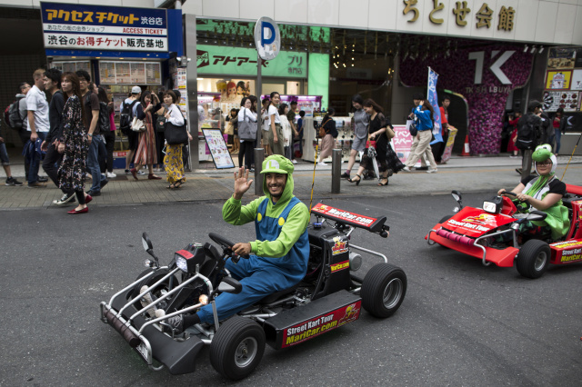 TOKYO, JAPAN - MAY 03:  Tourists wearing costumes of Nintendo game characters drive MariCar go-carts on a street in the Shibuya area on May 3, 2018 in Tokyo, Japan. Japan has kicked off Golden Week holiday, a series of national holidays starting in the last week of April.  (Photo by Tomohiro Ohsumi/Getty Images)