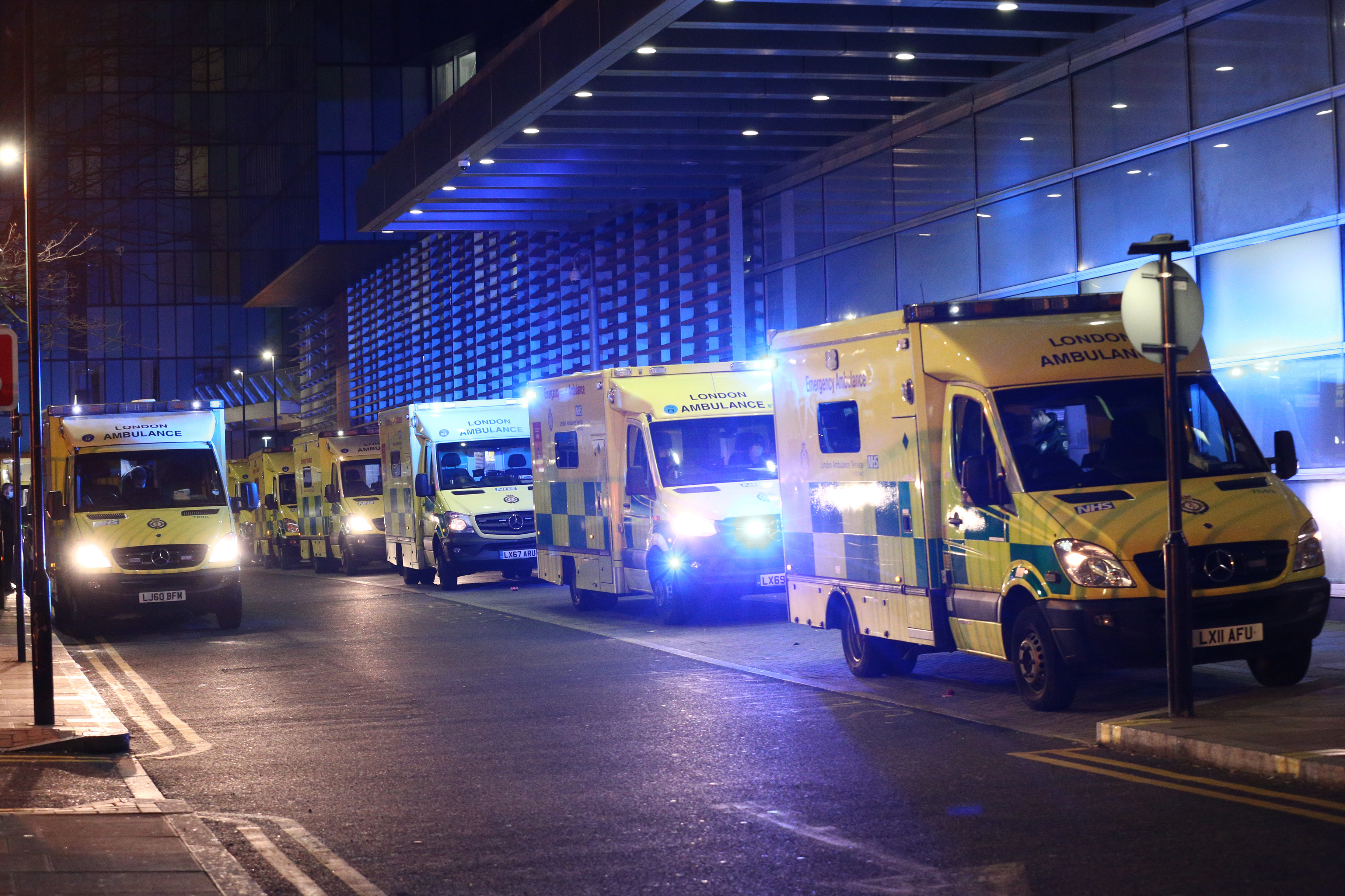 Ambulances queued outside the Royal London Hospital, in London. (Photo by Yui Mok/PA Images via Getty Images)
