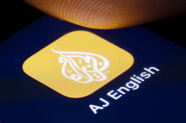 BERLIN, GERMANY - APRIL 22: The logo of the news channel Al Jazeera English is shown on the display of a smartphone on April 22, 2020 in Berlin, Germany. (Photo by Thomas Trutschel/Photothek via Getty Images)