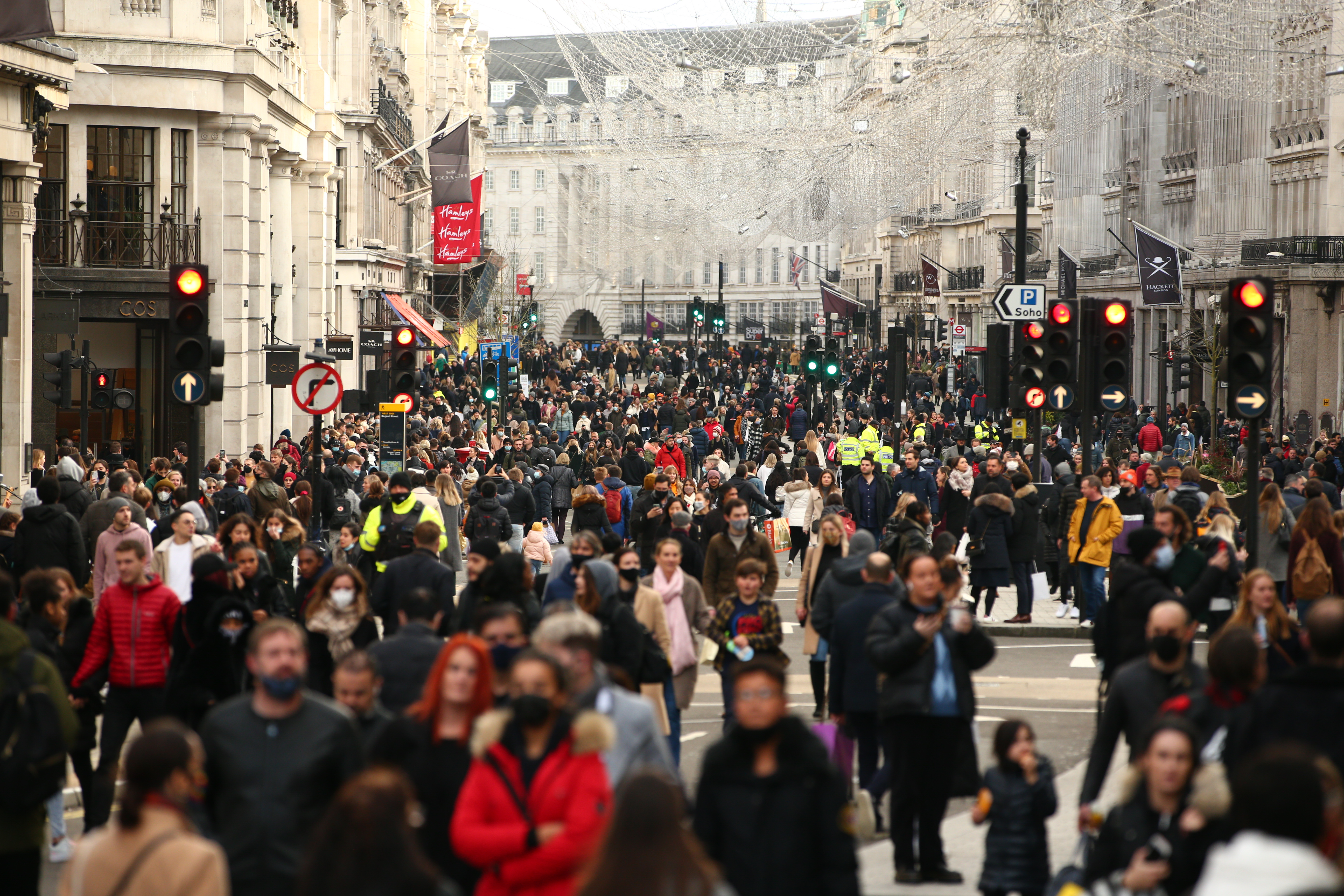 Shoppers fill a temporarily-pedestrianised Regent Street in London, England, on December 5, 2020. London has returned to so-called Tier 2 or 'high alert' coronavirus restrictions since the end of the four-week, England-wide lockdown last Wednesday, meaning a reopening of non-essential shops and hospitality businesses as the festive season gets underway. Rules under all three of England's tiers have been strengthened from before the November lockdown, however, with pubs and restaurants most severely impacted. In London's West End, meanwhile, Oxford Street and Regent Street were both packed with Christmas shoppers this afternoon, with the retail sector hoping for a strong end to one of its most difficult years. (Photo by David Cliff/NurPhoto via Getty Images)