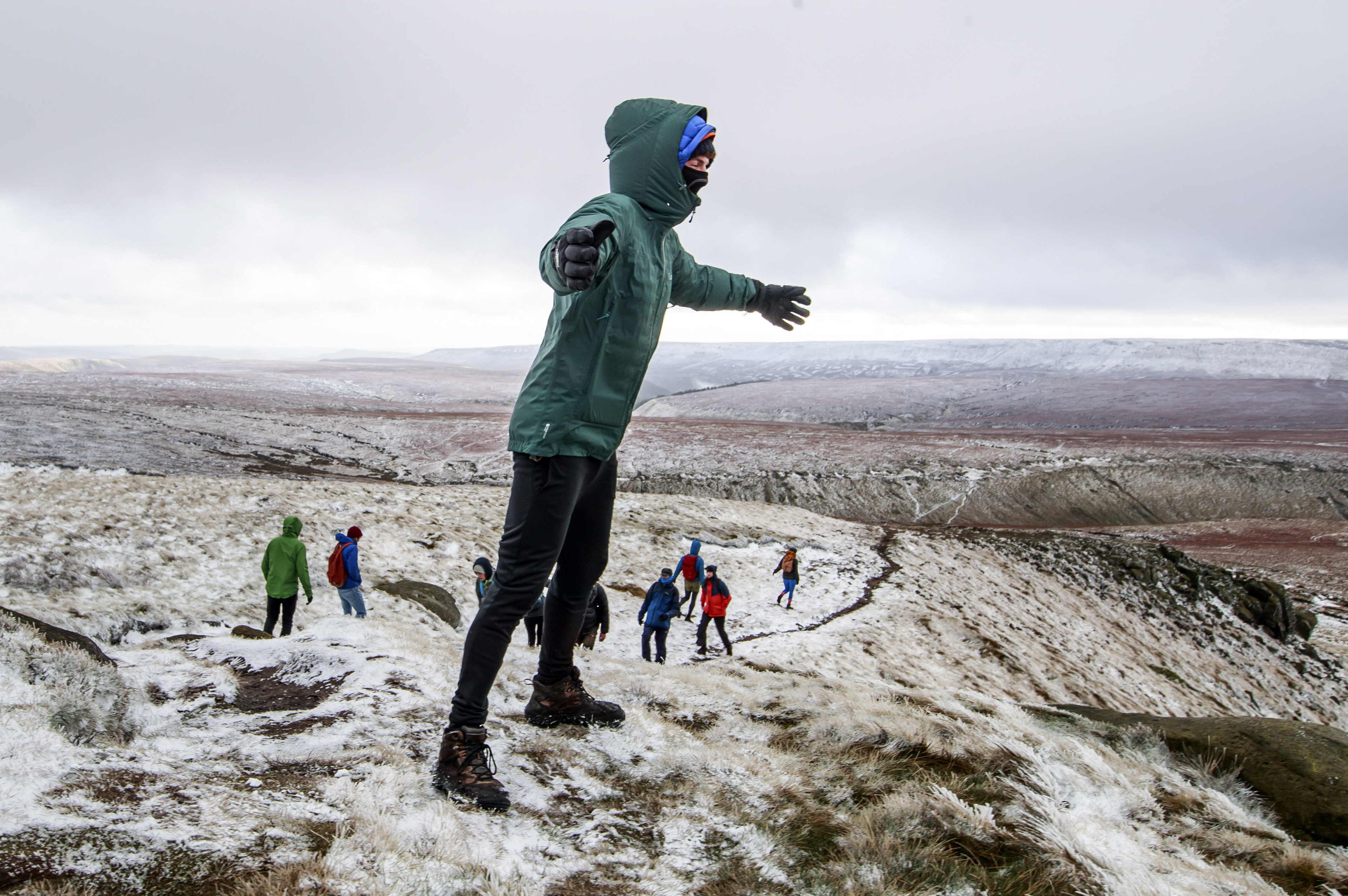 Hikers in snow on Bleaklow Moor in the Peak district of Derbyshire, after days of wet and wintry weather across the Christmas break, with a cold snap and icy conditions still to come.