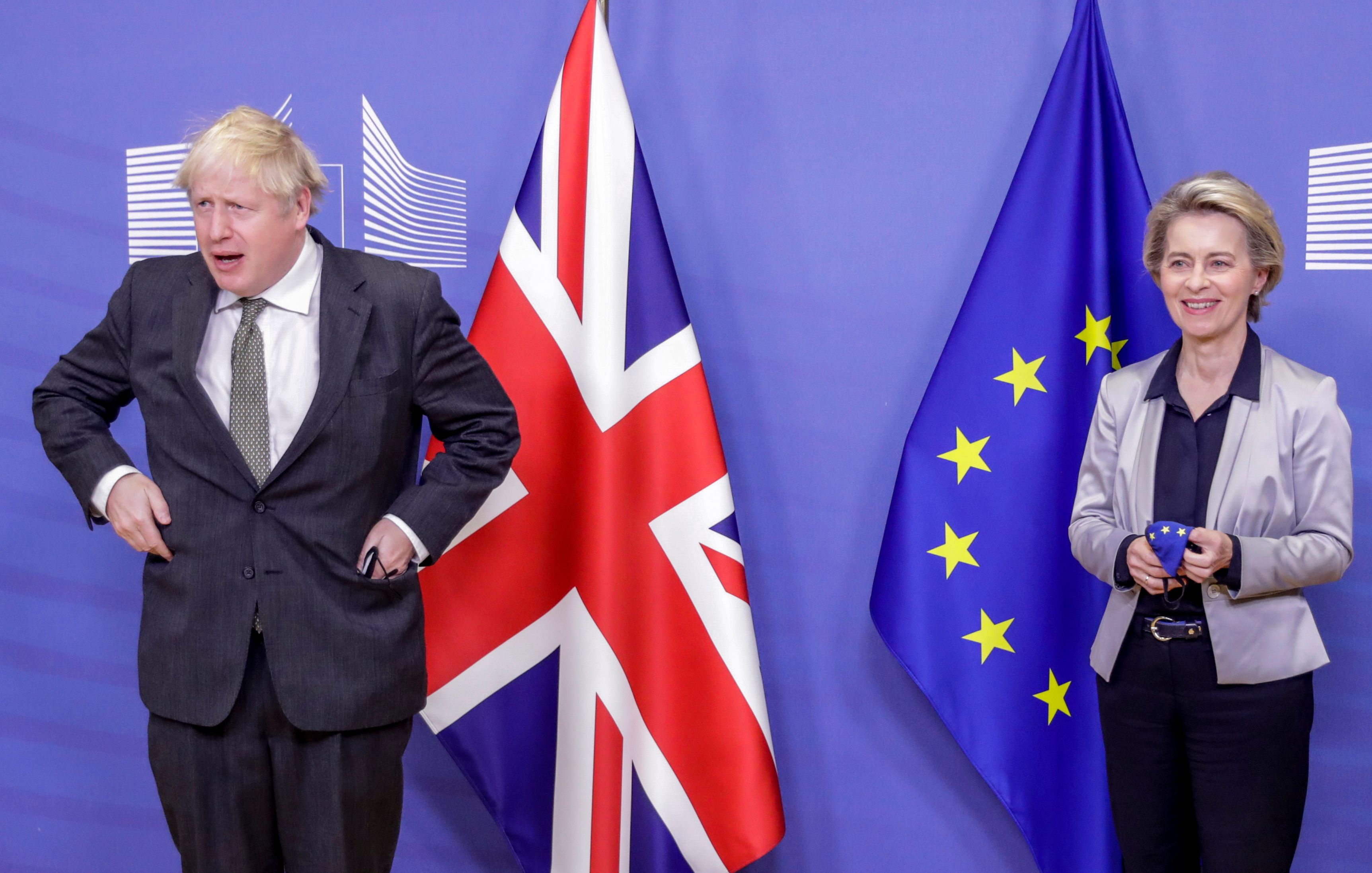 Britain's Prime Minister Boris Johnson (L) is welcomed by European Commission President Ursula von der Leyen (R) in the Berlaymont building at the EU headquarters in Brussels on December 9, 2020, prior to a post-Brexit talks' working dinner. - Britain's Prime Minister arrives in Brussels on December 9, 2020, with hopes for a post-Brexit trade deal hanging on crisis talks with EU chief. Talks are blocked over the issue of fair competition, with Britain refusing to accept a mechanism that would allow the EU to respond swiftly if UK and EU business rules diverge over time and put European firms at a disadvantage. (Photo by Olivier HOSLET / POOL / AFP) (Photo by OLIVIER HOSLET/POOL/AFP via Getty Images)