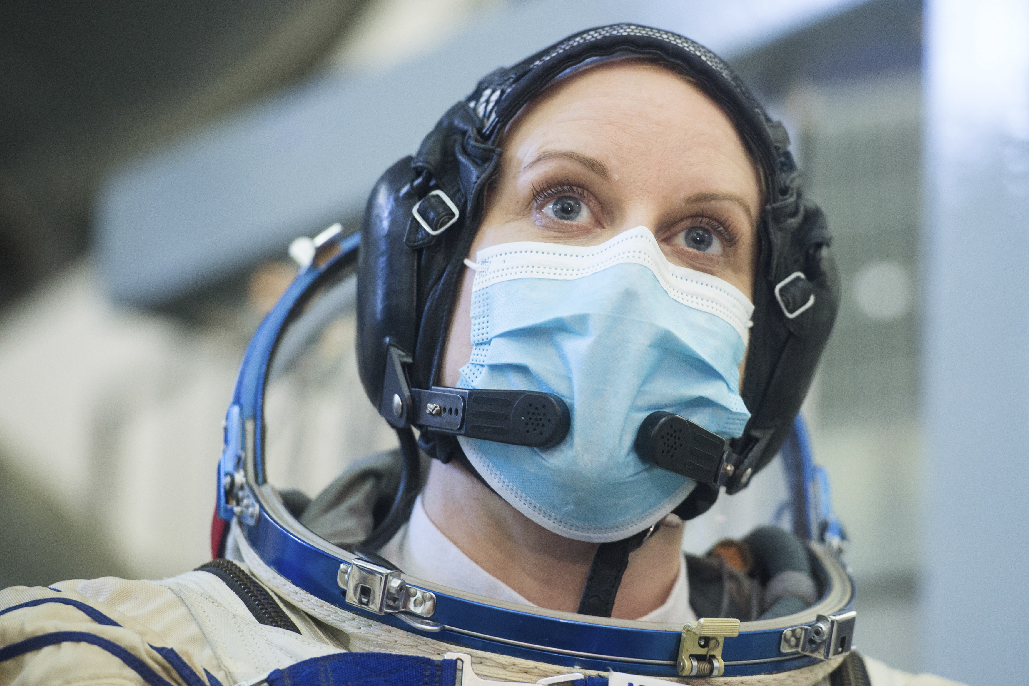 In this photo released by the Russian Space Agency Roscosmos, International Space Station (ISS) Expedition 64th crew member, U.S. astronaut Kathleen Rubins wearing a face mask to protect against coronavirus looks on during a final preflight practical examination in a mock-up of a Soyuz space craft at the Gagarin Cosmonaut Training Centre in Star City, outside Moscow, Russia Wednesday, Sept. 23, 2020. The launch of the Soyuz MS-17 spacecraft from the Baikonur spaceport is scheduled for October 14. (Andrey Shelepin/Roscosmos Space Agency Press Service via AP)