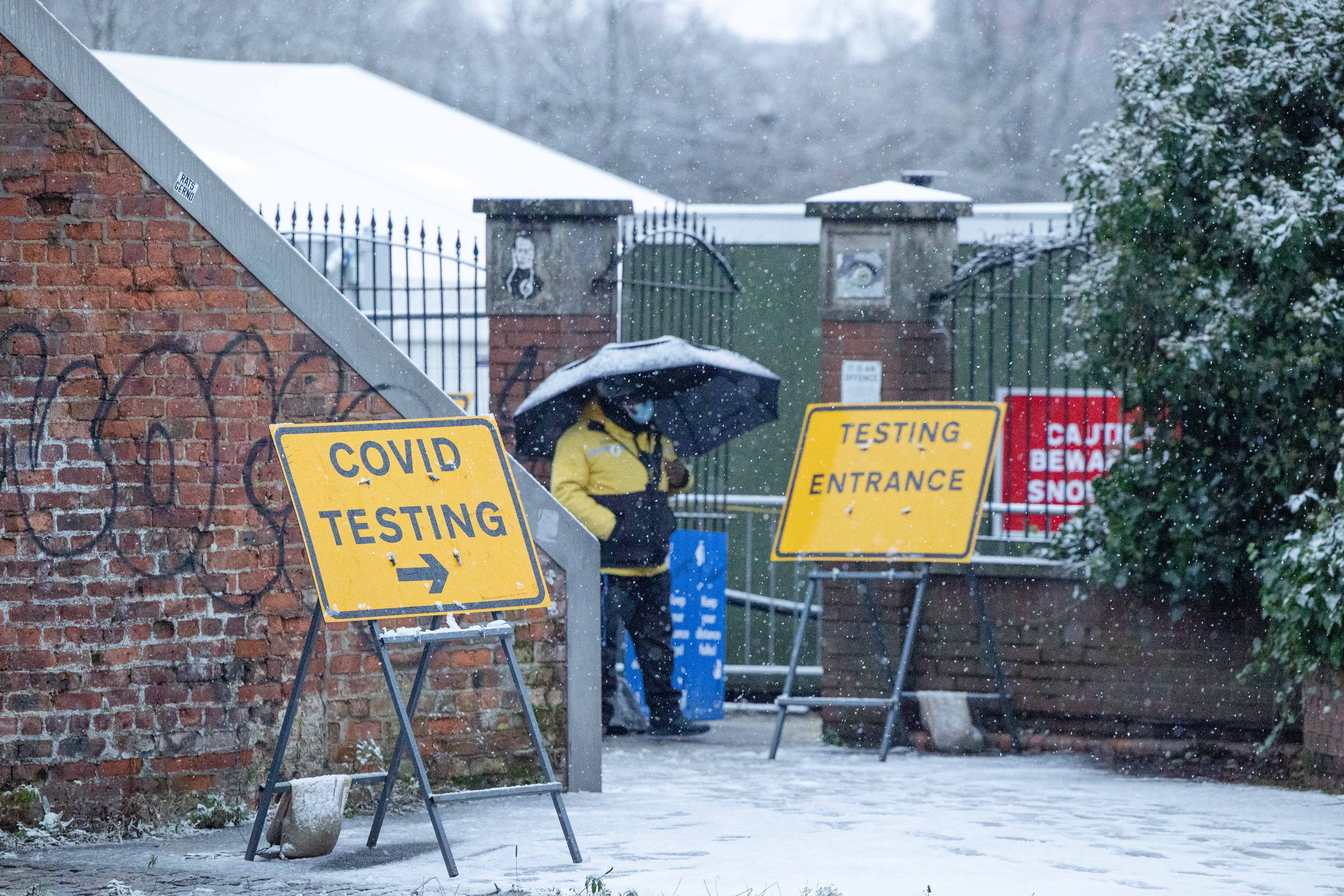 A COVID-19 testing centre continues to operate in Ancoats, Manchester city centre, as snow hits the UK. Tuesday 29th December 2020.  (Photo by Pat Scaasi/MI News/NurPhoto via Getty Images)