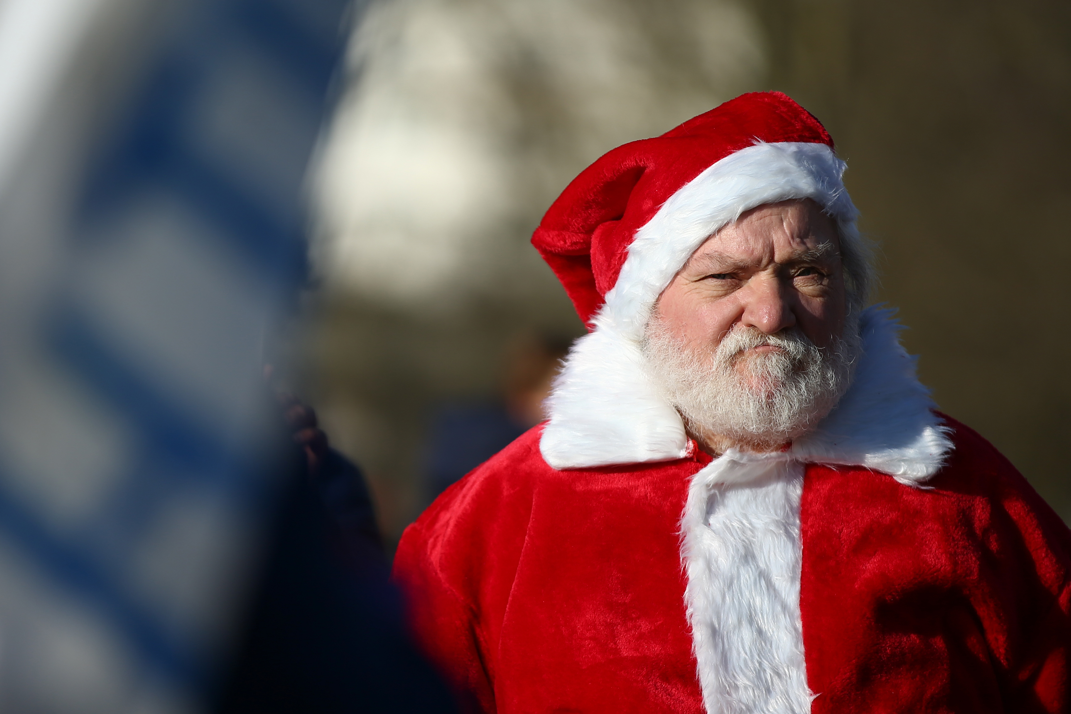 LONDON, ENGLAND - DECEMBER 05: A man dressed as Santa Claus attends a demonstration against the current Covid-19 restrictions in Hyde Park on December 5, 2020 in London, England. London has been in Tier 2 restrictions since the lockdown ended on December 2. (Photo by Hollie Adams/Getty Images)