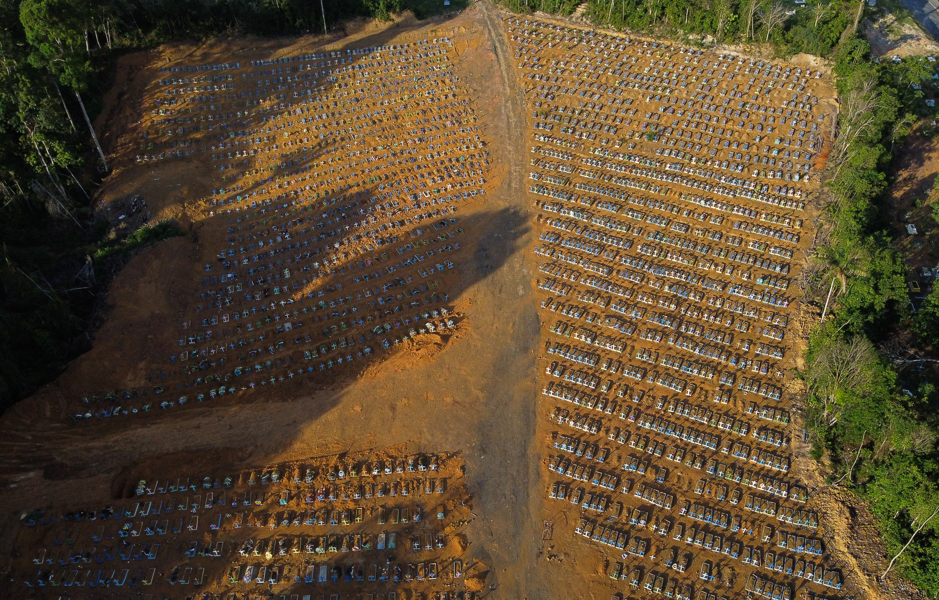 Aerial view of the burial site reserved for victims of the COVID pandemic at the Nossa Senhora Aparecida cemetery in Manaus, in the Amazon forest in Brazil on November 21, 2020. - Brazil has been one of the countries hit hardest by the pandemic, with more than 166,000 people killed, the second-highest number in the world, following the United States and is bracing for a possible second wave of mass infections as it races to test and then distribute its first 120,000 doses of Coronavac, a potential COVID-19 vaccine developed by Chinese lab Sinovac Biotech. (Photo by MICHAEL DANTAS / AFP) (Photo by MICHAEL DANTAS/AFP via Getty Images)