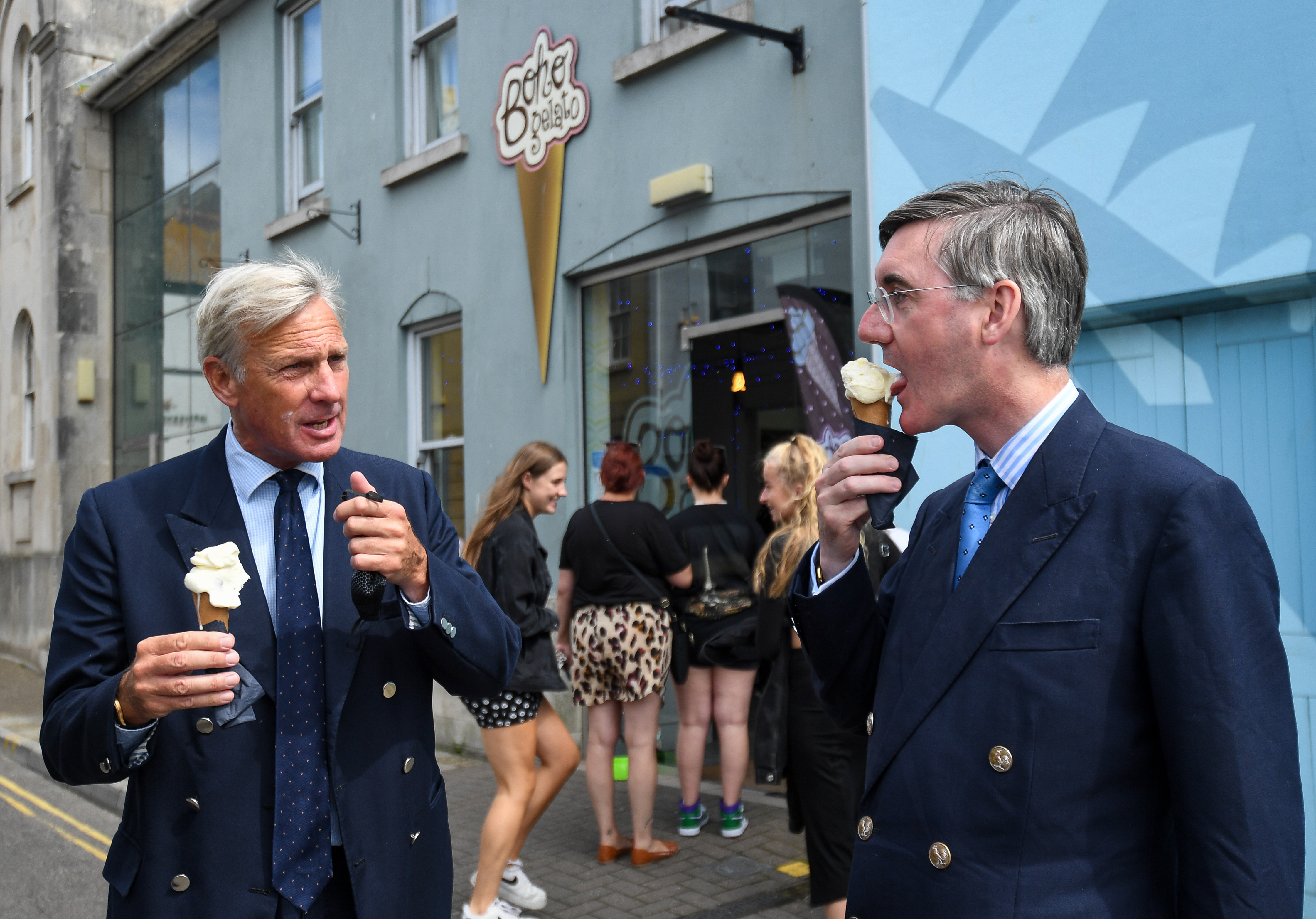 WEYMOUTH, ENGLAND - AUGUST 18: MP for North East Somerset, Jacob Rees-Mogg (R) visits Boho Gelato ice cream parlour with Richard Drax MP at the harbourside on August 18, 2020 in Weymouth, England. (Photo by Finnbarr Webster/Getty Images)