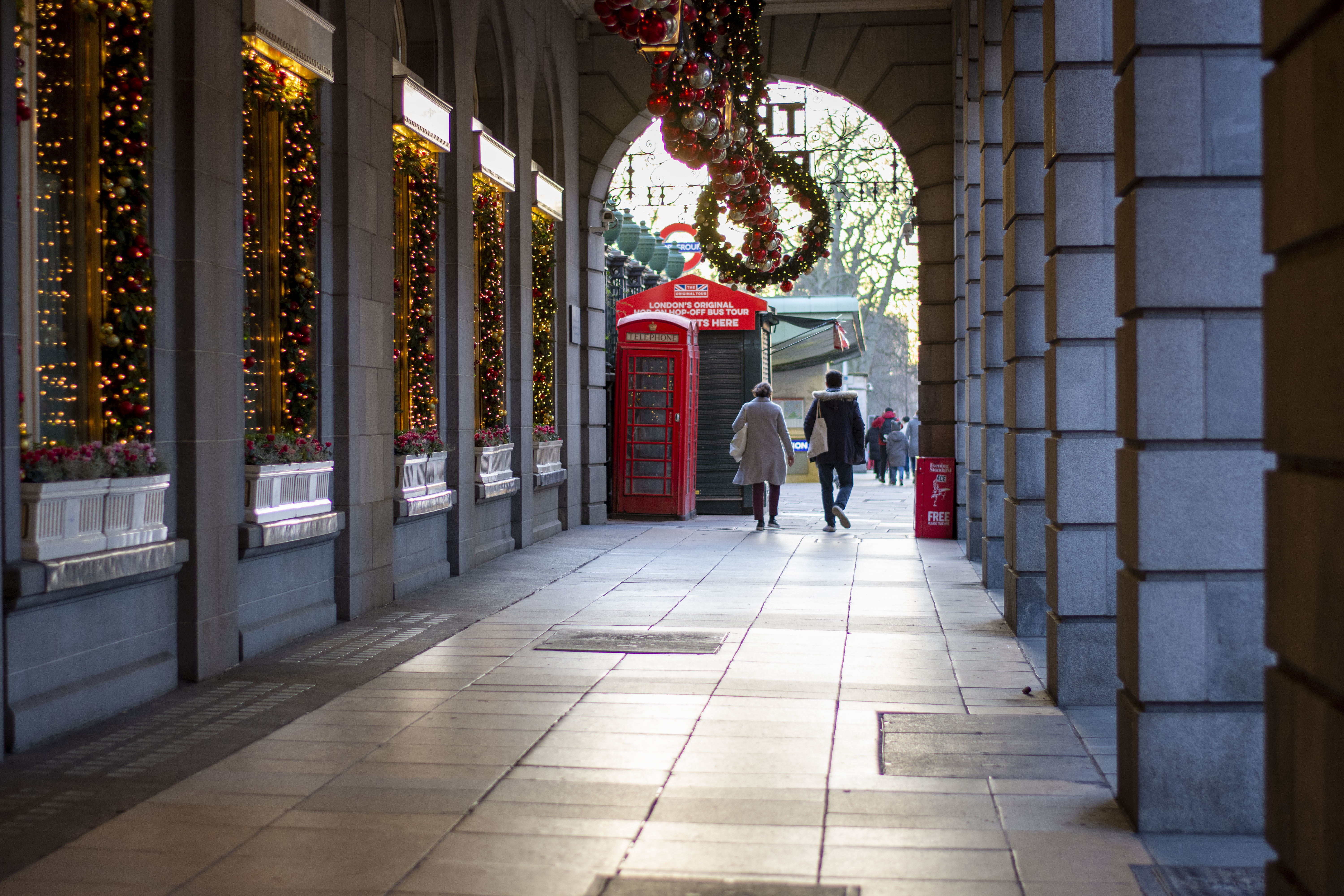 A couple walks past Christmas decorations at the Ritz London. Under tier four restrictions, pubs and restaurants will close, as well as �non-essential� retail. (Photo by Pietro Recchia / SOPA Images/Sipa USA)
