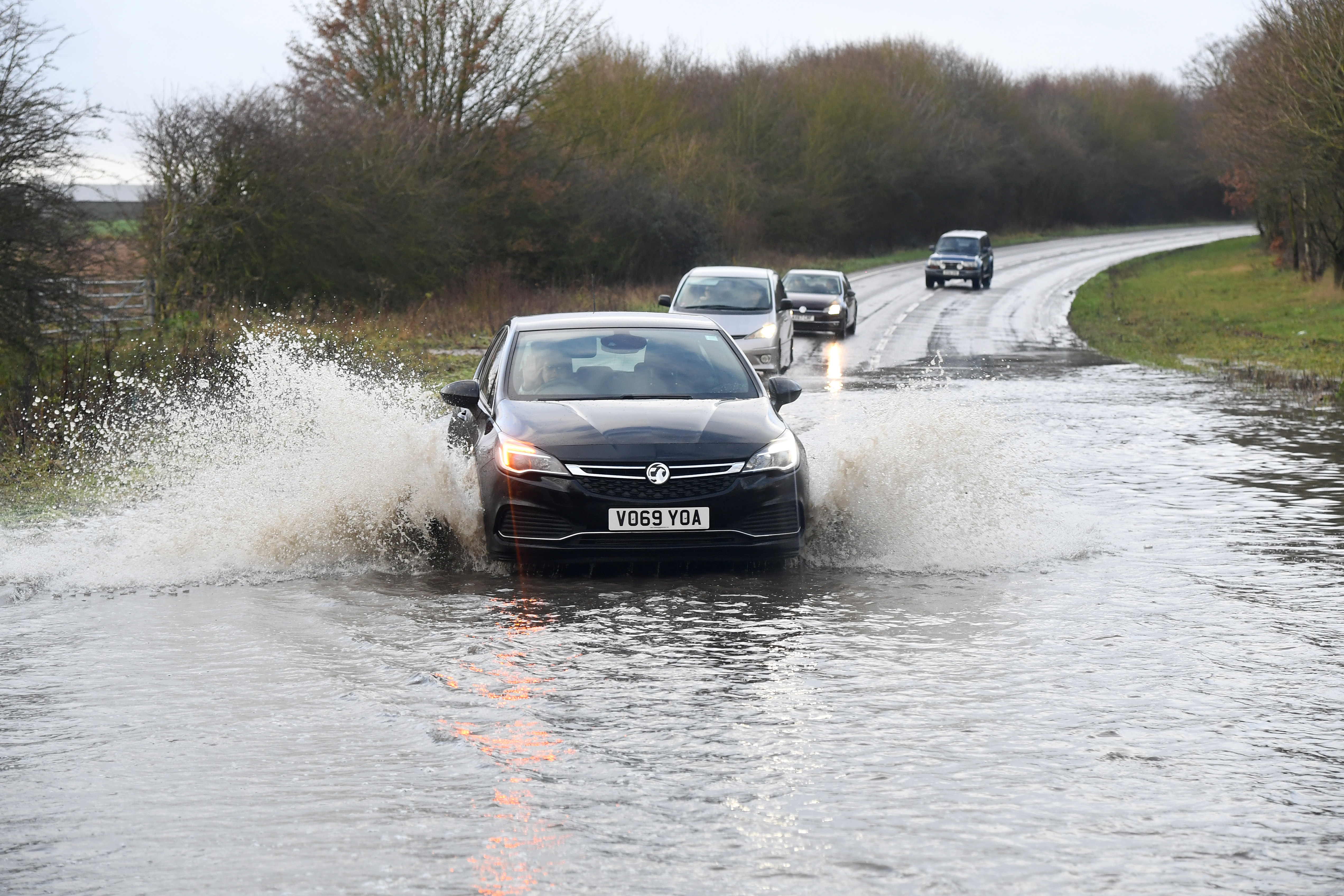 SUFFOLK, ENGLAND - DECEMBER 24: People drive through a flooded road following heavy rainfall on December 24, 2020 in Suffolk, United Kingdom . (Photo by Dave J Hogan/Getty Images)
