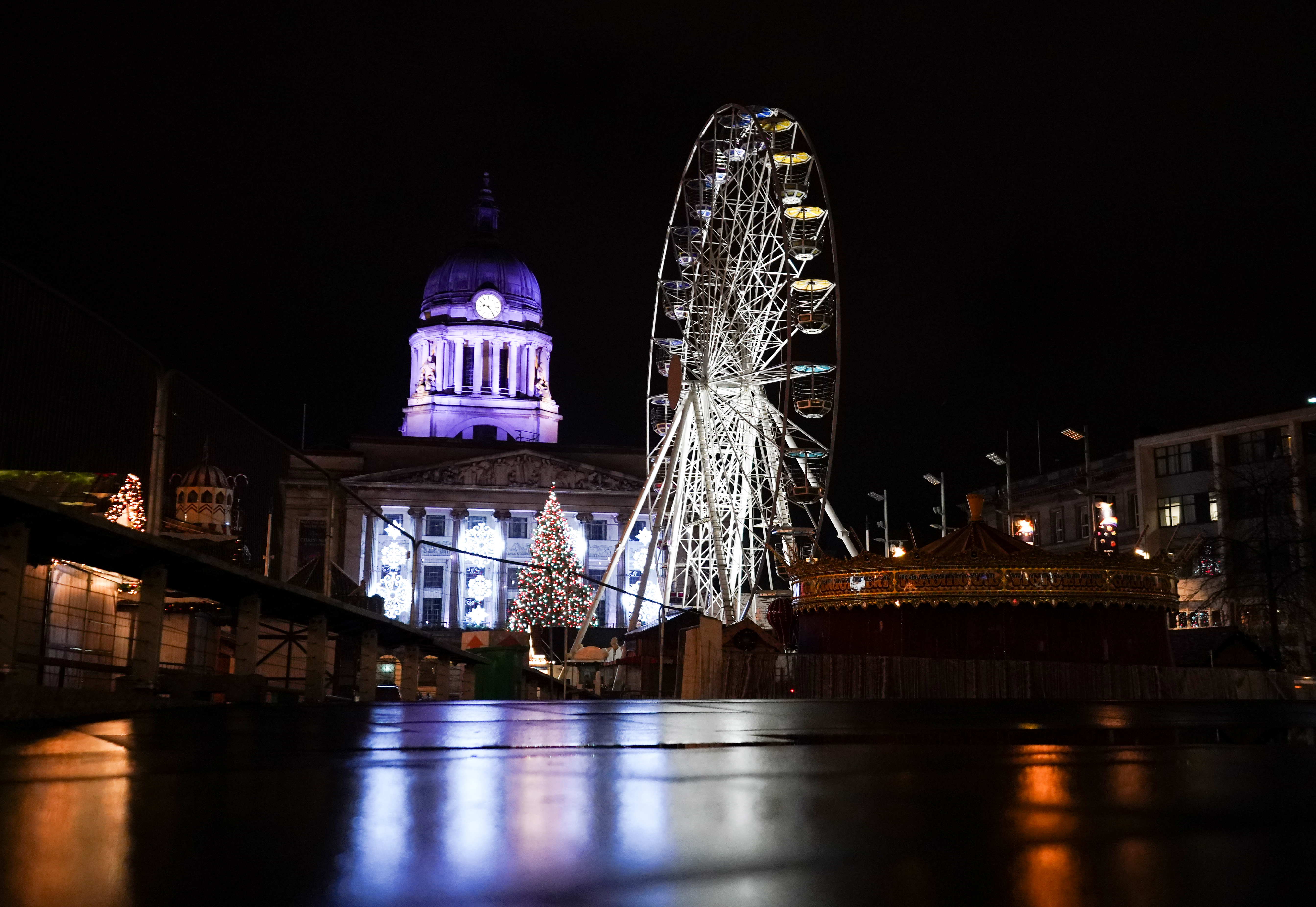 An empty Christmas market on a quiet evening in Nottingham city centre. (Photo by Zac Goodwin/PA Images via Getty Images)