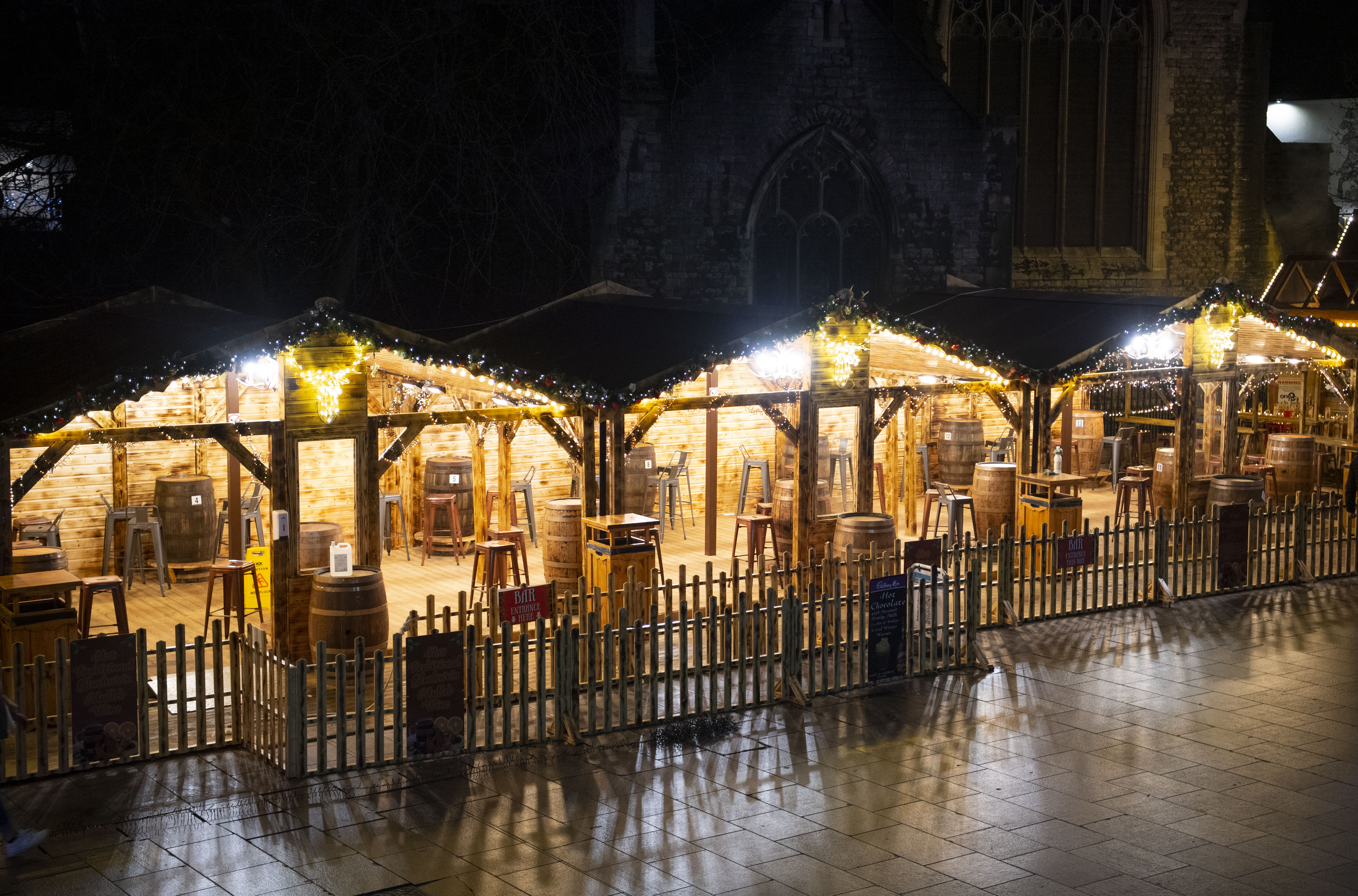 CARDIFF, WALES - DECEMBER 04: A general view of an empty Christmas market bar on the Hayes on December 4, 2020 in Cardiff, Wales. Following a firebreak period that ran from October 23 to November 9 the Welsh Government have introduced new rules which will prevent pubs, restaurants and cafes from selling alcohol at any time from 6pm on Friday. The rules will be reviewed on December 17. (Photo by Matthew Horwood/Getty Images)