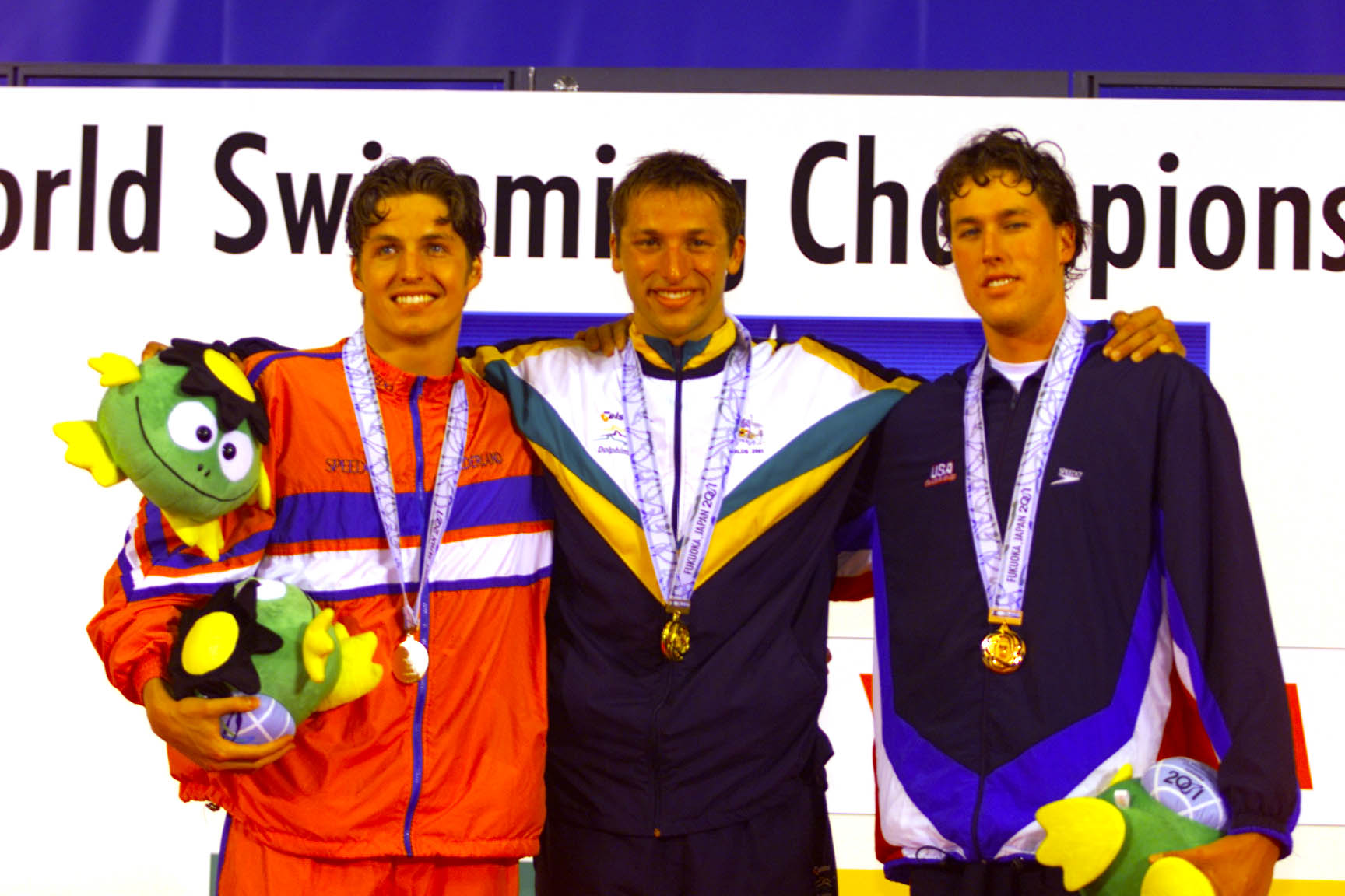 24 Jul 2001:   Pieter Van Den Hoogenband of the Netherlands (left-silver), Ian Thorpe of Australia (gold-center), and Klete Keller of the USA (right-bronze) stand on the medal podium following the men's 200M Freestyle during the finals at the Marine Messe Pool during the World Swimming Champs in Fukuoka, Japan. DIGITAL IMAGE. Mandatory Credit: Donald Miralle/ALLSPORT