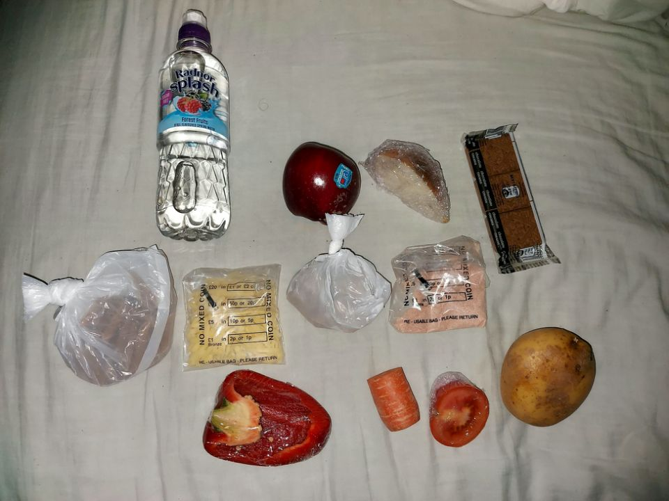A mum from Bournemouth shared a picture of the food package her 17-year-old received - which included a third of an onion. (SWNS)