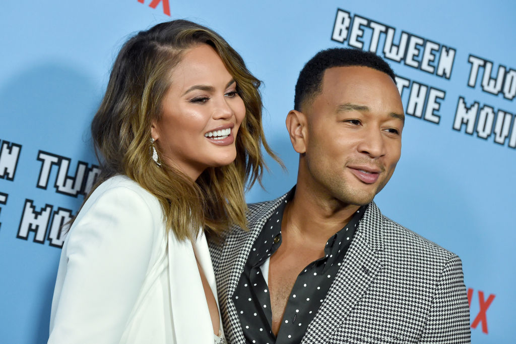 Watch Chrissy Teigen get a back tattoo of lyrics from husband John Legend's sexy song 'Ooh Laa'