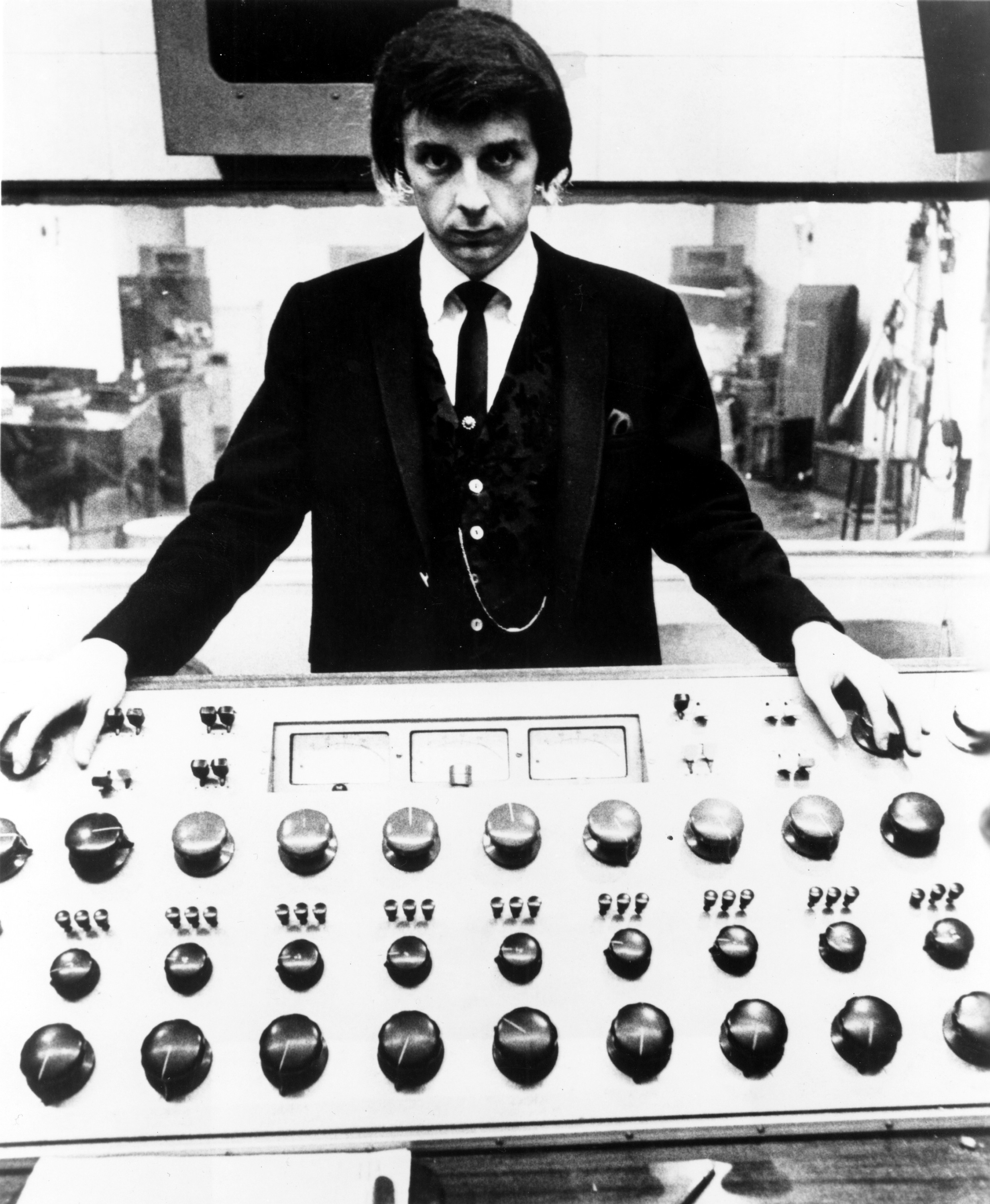 LOS ANGELES - 1966: Producer Phil Spector poses at the mixing board during a recording session at Gold Star Studios in 1966 in Los Angeles, California. (Photo by Michael Ochs Archives/Getty Images)