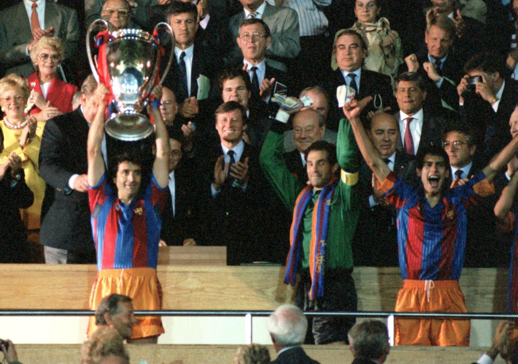 (L-R) Barcelona's Juan Carlos Moreno lifts the European Cup as goalkeeper Andoni Zubizarreta and Josep Guardiola celebrate
