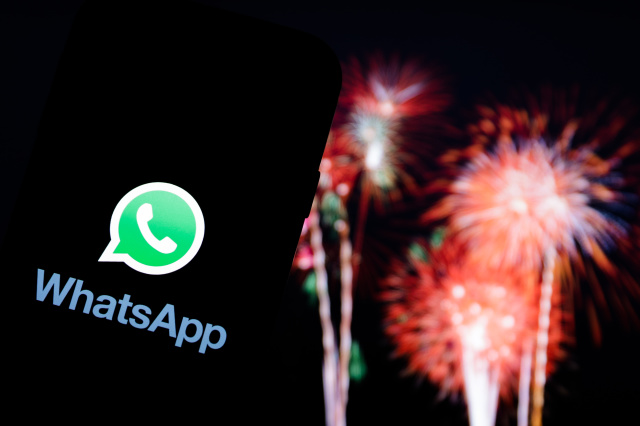 POLAND - 2020/12/30: In this photo illustration a Whatsapp logo seen displayed on a smartphone with fireworks in the background. (Photo Illustration by Filip Radwanski/SOPA Images/LightRocket via Getty Images)