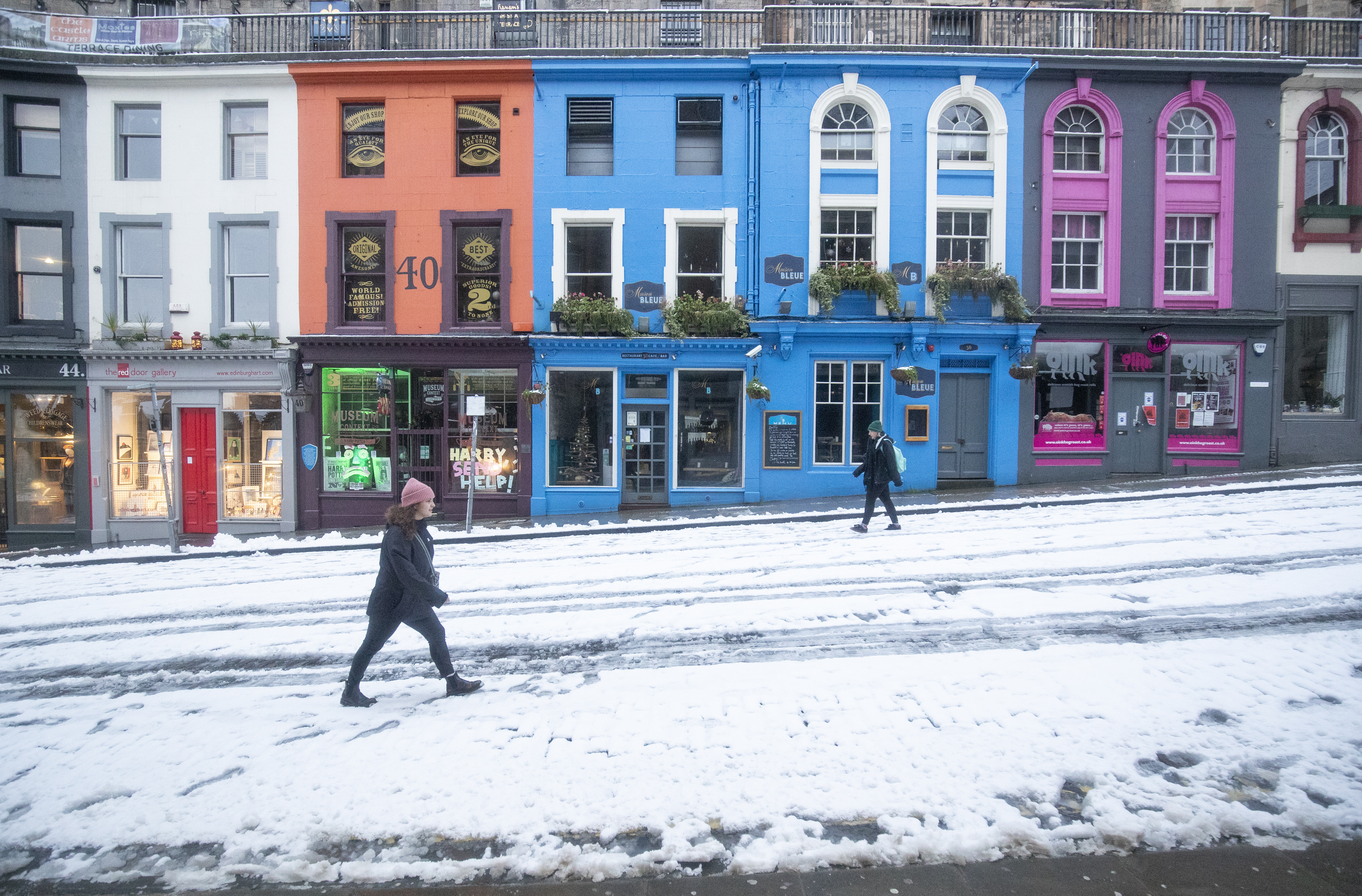 People walk through the snow down along Victoria Street in Edinburgh. Picture date: Thursday January 21, 2021. (Photo by Jane Barlow/PA Images via Getty Images)