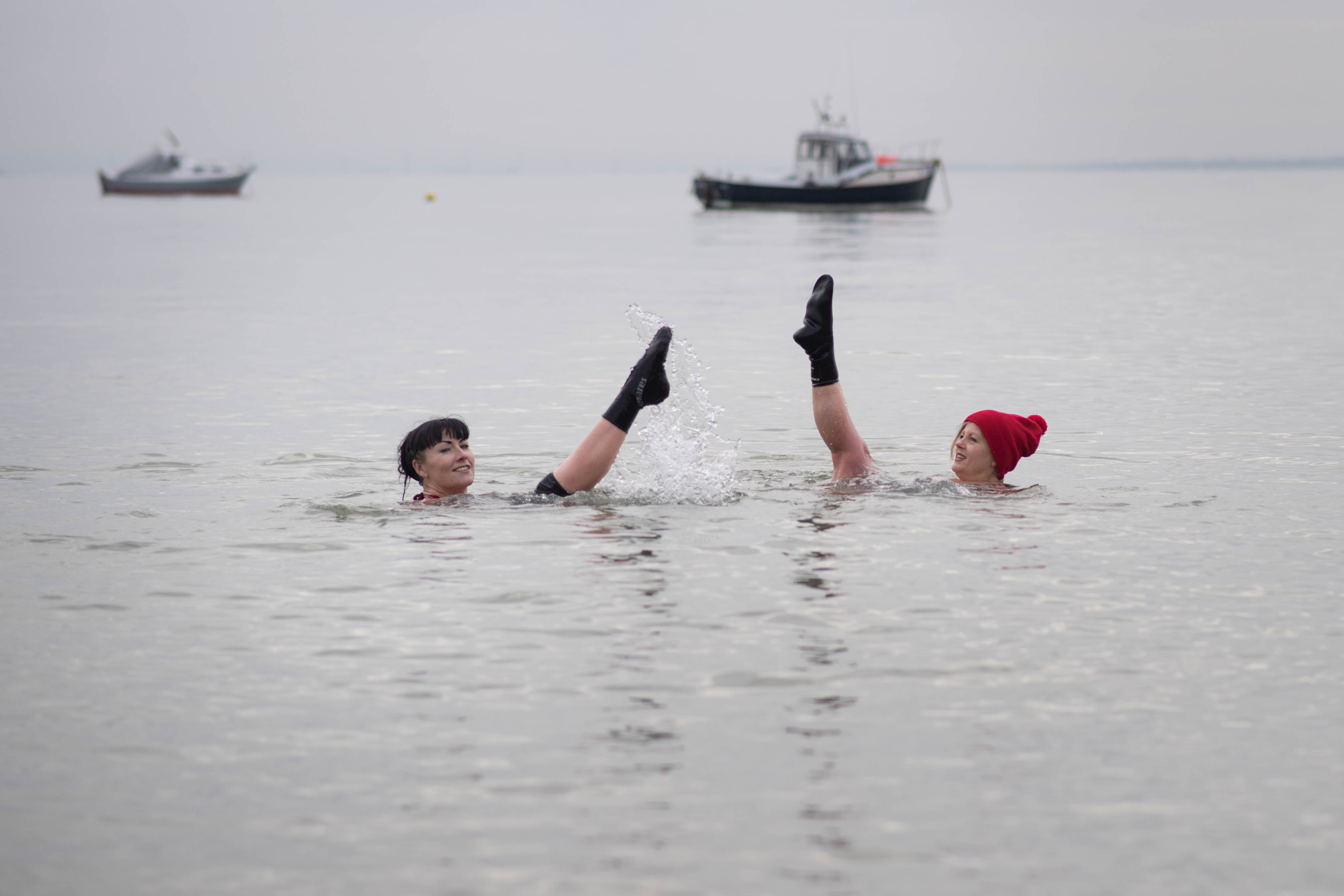 Swimmer at Thorpe Bay near Southend in Essex. Heavy snow and freezing rain is set to batter the UK this week, with warnings issued over potential power cuts and travel delays.