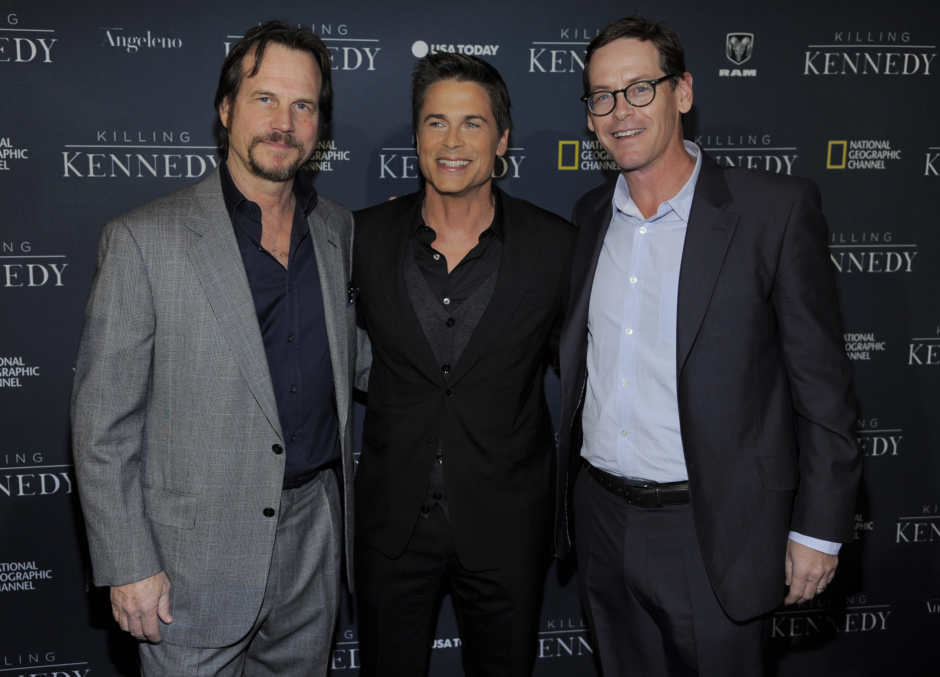 """Rob Lowe, center, star of the film """"Killing Kennedy,"""" poses with actor Bill Paxton, left, and Howard T. Owens, president of National Geographic Channel, at the premiere of the film """"Killing Kennedy"""" at the Saban Theatre on Monday, Nov. 4, 2013 in Beverly Hills, Calif. (Photo by Chris Pizzello/Invision/AP)"""