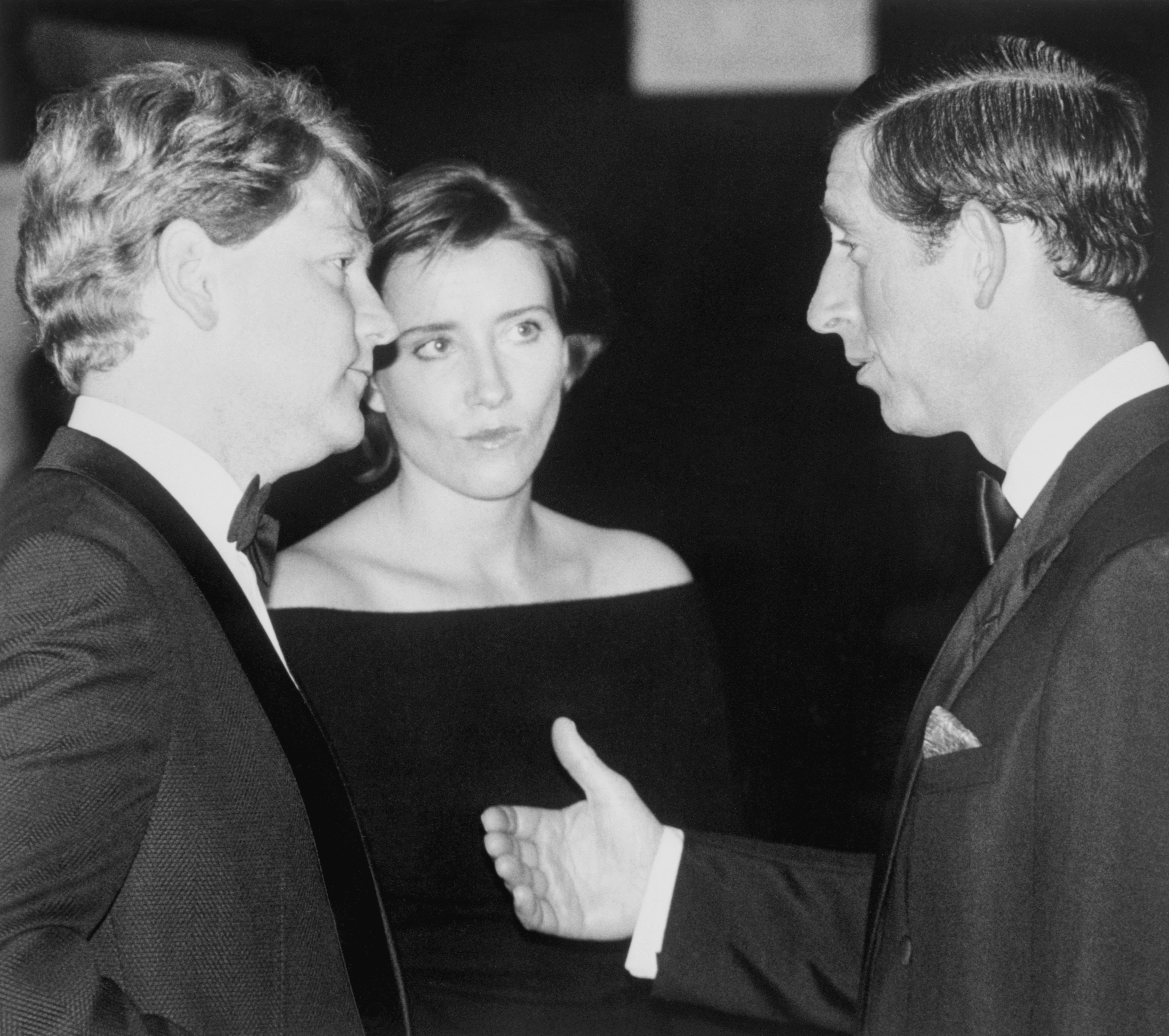 Prince Charles (r) talks with actor-director Kenneth Branagh and his actress wife Emma Thompson at the Royal World Charity premiere of Branagh's film version of Henry V at the Odeon Leicester Square, London. Branagh starred in the title role and his wife played Princess Katherine.   (Photo by PA Images via Getty Images)