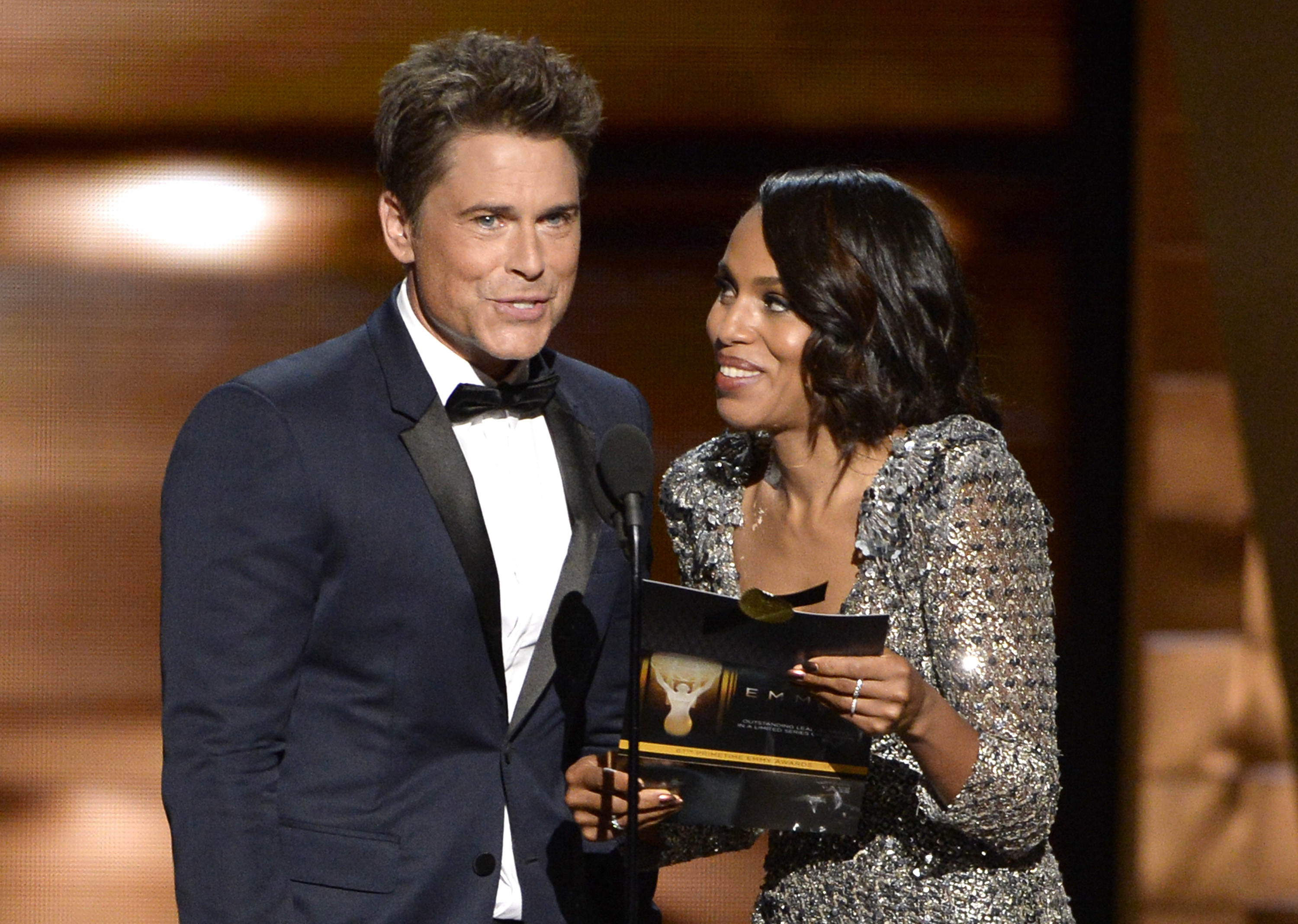 Rob Lowe, left, and Kerry Washington present the award for outstanding lead actress in a limited series or a movie at the 67th Primetime Emmy Awards on Sunday, Sept. 20, 2015, at the Microsoft Theater in Los Angeles. (Photo by Phil McCarten/Invision for the Television Academy/AP Images)