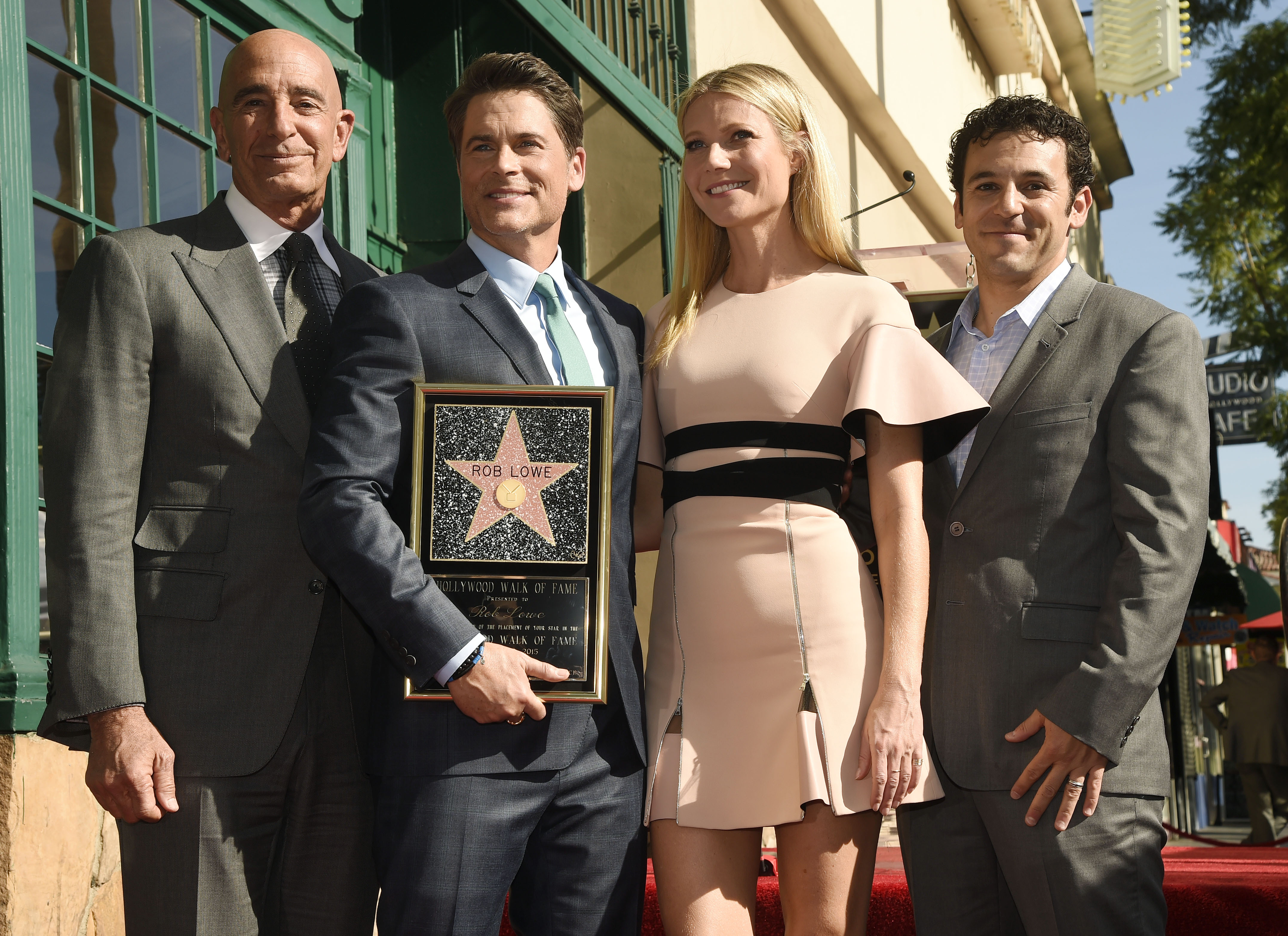 Actor Rob Lowe, second from left, poses with, left to right, Miramax Chairman Tom Barrack, actress Gwyneth Paltrow and actor Fred Savage after receiving a star on the Hollywood Walk of Fame on Tuesday, Dec. 8, 2015, in Los Angeles. (Photo by Chris Pizzello/Invision/AP)