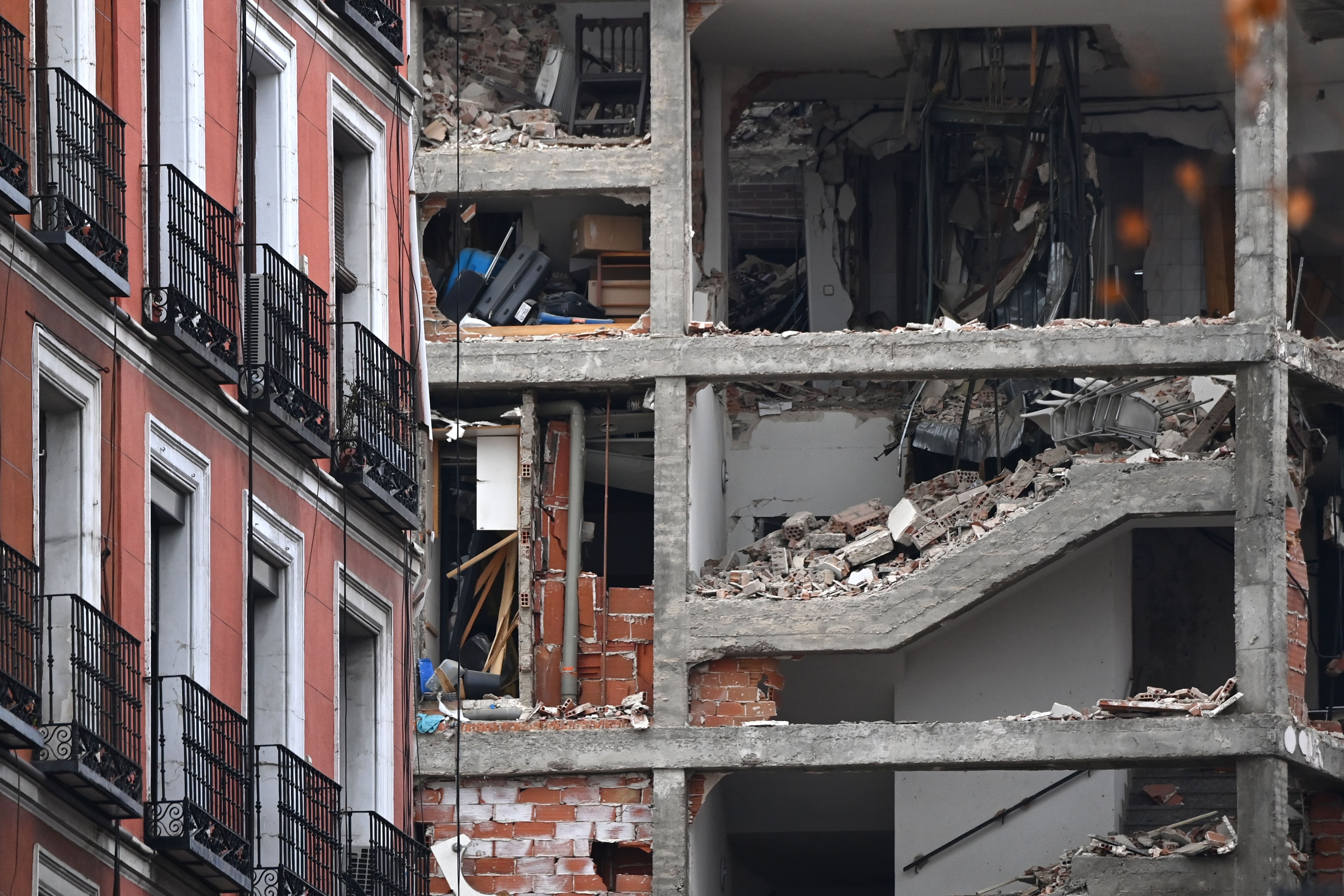 A damaged building is pictured in Madrid on January 20, 2021 after a strong explosion rocked the building. - The cause of the blast was not immediately clear. (Photo by GABRIEL BOUYS / AFP) (Photo by GABRIEL BOUYS/AFP via Getty Images)
