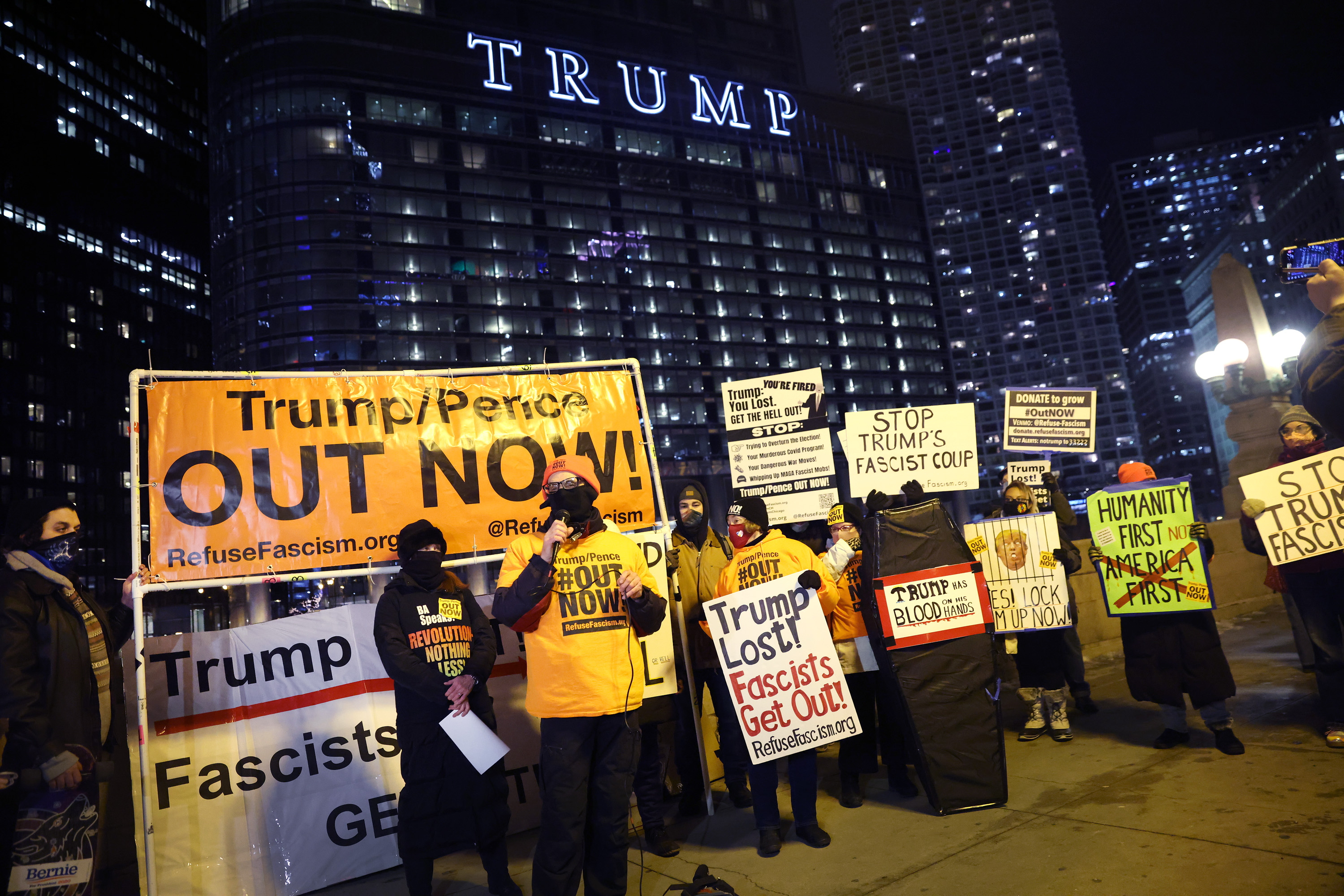 CHICAGO, ILLINOIS - JANUARY 07: A small group of demonstrators protests near Trump Tower on January 07, 2021 in Chicago, Illinois. They called for the removal of President Donald Trump from office after a pro-Trump mob stormed the Capitol building in Washington, DC yesterday as lawmakers met to count the Electoral College votes in the presidential election.  (Photo by Scott Olson/Getty Images)