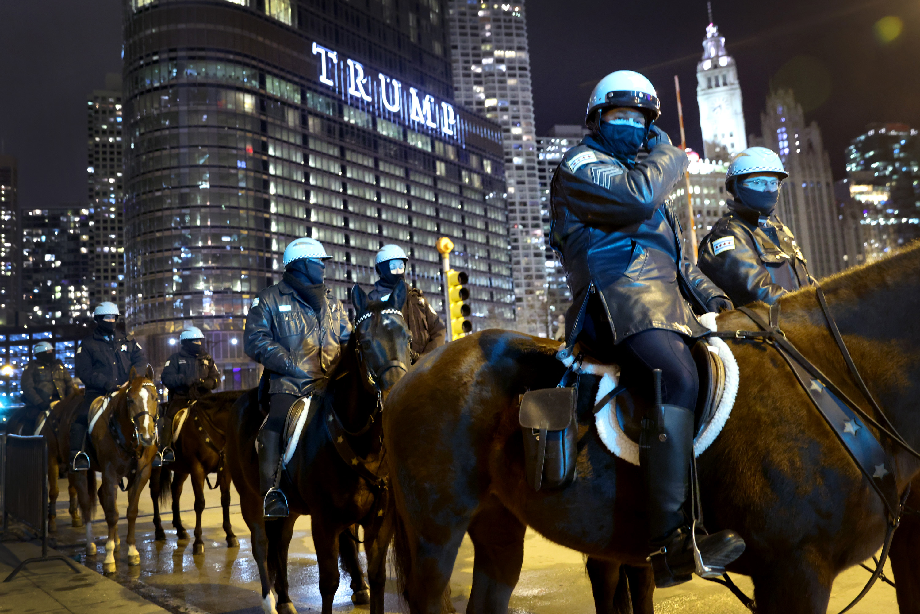 CHICAGO, ILLINOIS - JANUARY 07: Police keep watch as a small group of demonstrators protest near Trump Tower on January 07, 2021 in Chicago, Illinois. Protesterdscalled for the removal of President Donald Trump from office after a pro-Trump mob stormed the Capitol building in Washington, DC yesterday as lawmakers met to count the Electoral College votes in the presidential election.  (Photo by Scott Olson/Getty Images)