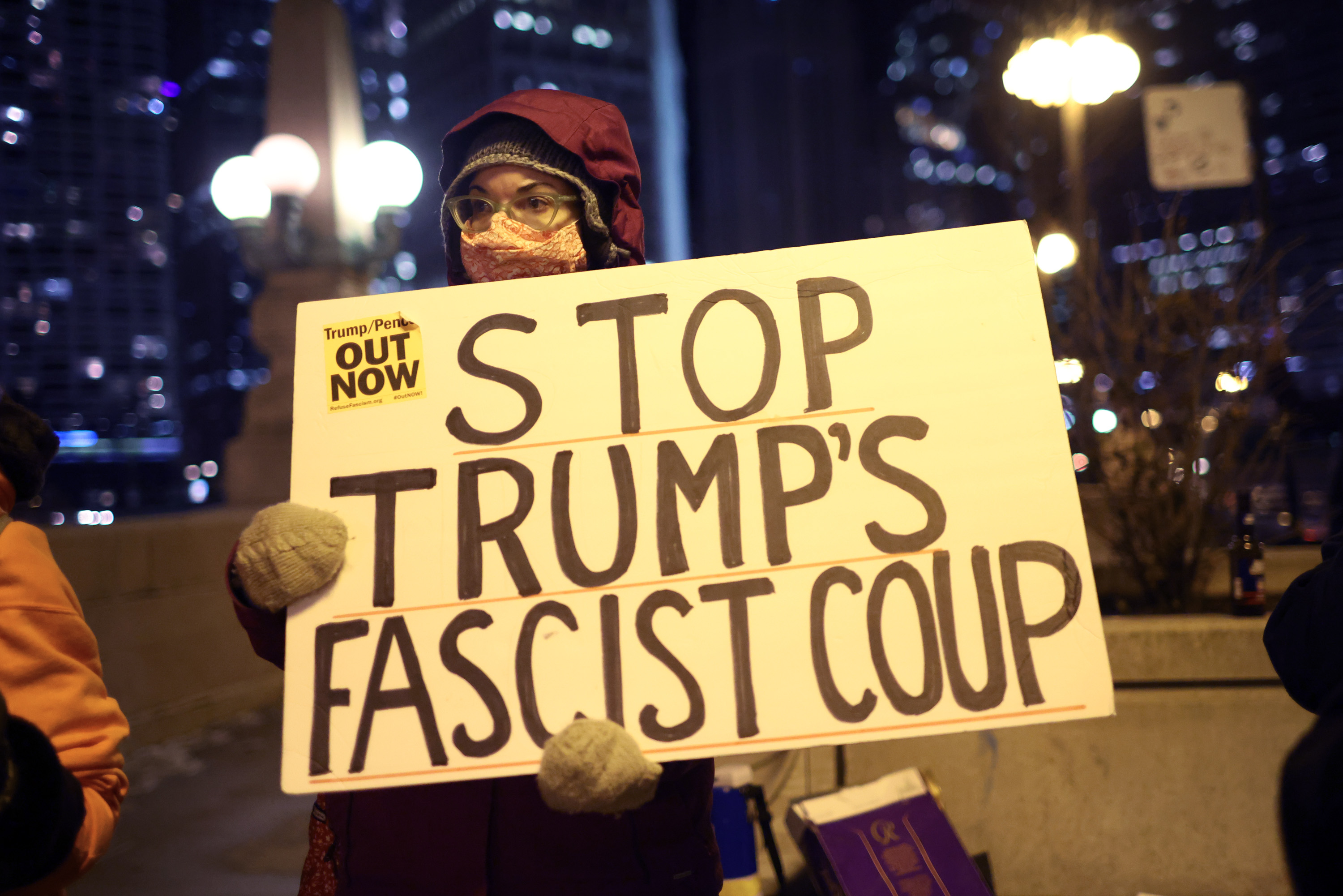 CHICAGO, ILLINOIS - JANUARY 07: A small group of demonstrators protest near Trump Tower on January 07, 2021 in Chicago, Illinois. They called for the removal of President Donald Trump from office after a pro-Trump mob stormed the Capitol building in Washington, DC yesterday as lawmakers met to count the Electoral College votes in the presidential election.  (Photo by Scott Olson/Getty Images)