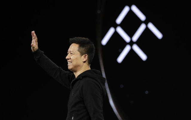 LeEco CEO YT Jia waves during the unveiling of Faraday Future's FF91 electric car at CES International Tuesday, Jan. 3, 2017, in Las Vegas. (AP Photo/Jae C. Hong)