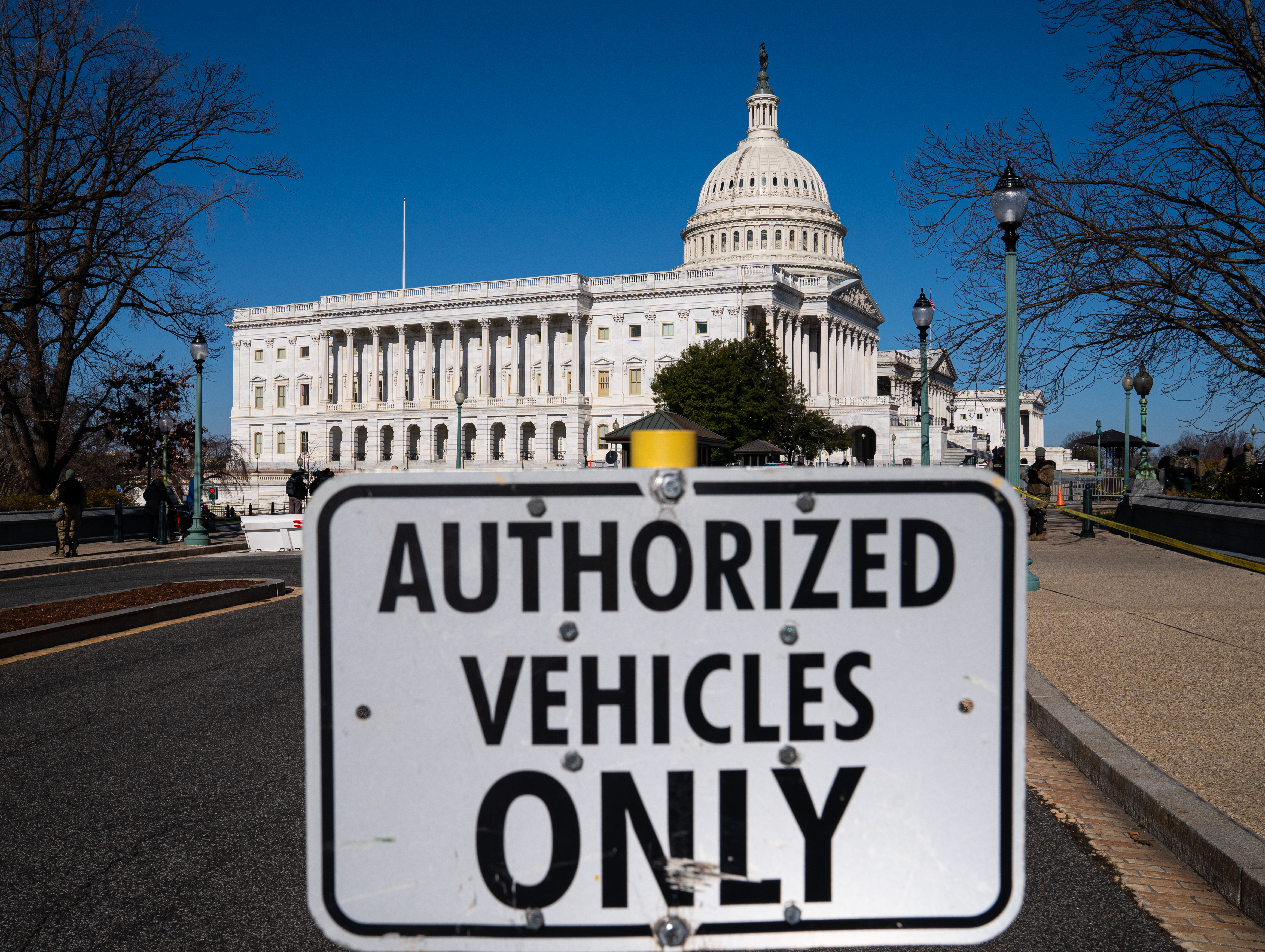 WASHINGTON, DC - JANUARY 07: A traffic sign stands at one of the front gates to the U.S. Capitol on January 7, 2021 in Washington, DC. A pro-Trump mob stormed and desecrated the building the day before as Congress held a joint session to ratify President-elect Joe Biden's 306-232 Electoral College win over President Donald Trump. (Photo by Robert Nickelsberg/Getty Images)