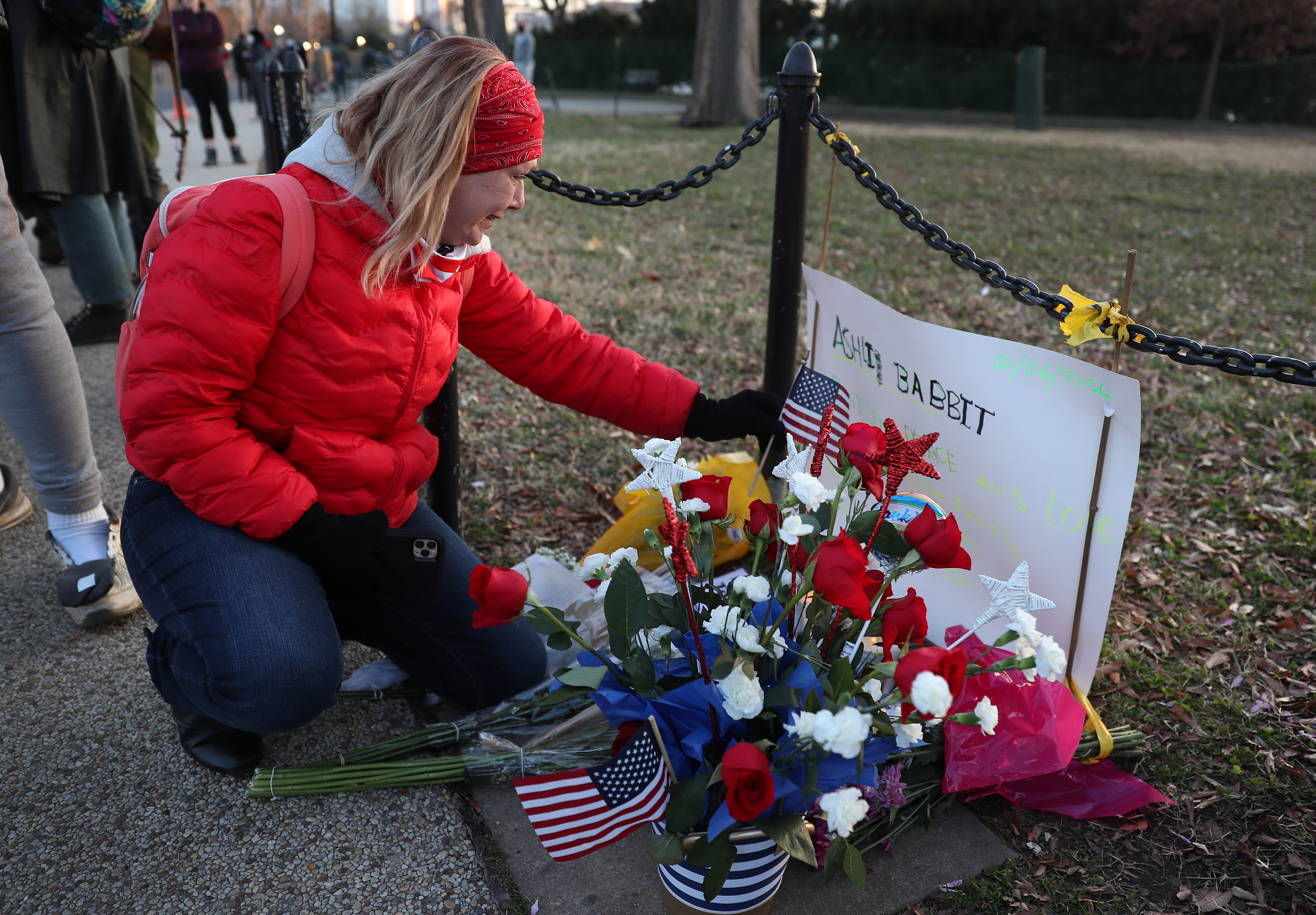 WASHINGTON, DC - JANUARY 07:  Melody Black, from Minnesota, becomes emotional as she visits a memorial setup near the U.S. Capitol Building for Ashli Babbitt who was killed in the building after a pro-Trump mob broke in on January 07, 2021 in Washington, DC. Congress finished tallying the Electoral College votes and Joe Biden was certified as the winner of the 2020 presidential election. (Photo by Joe Raedle/Getty Images)