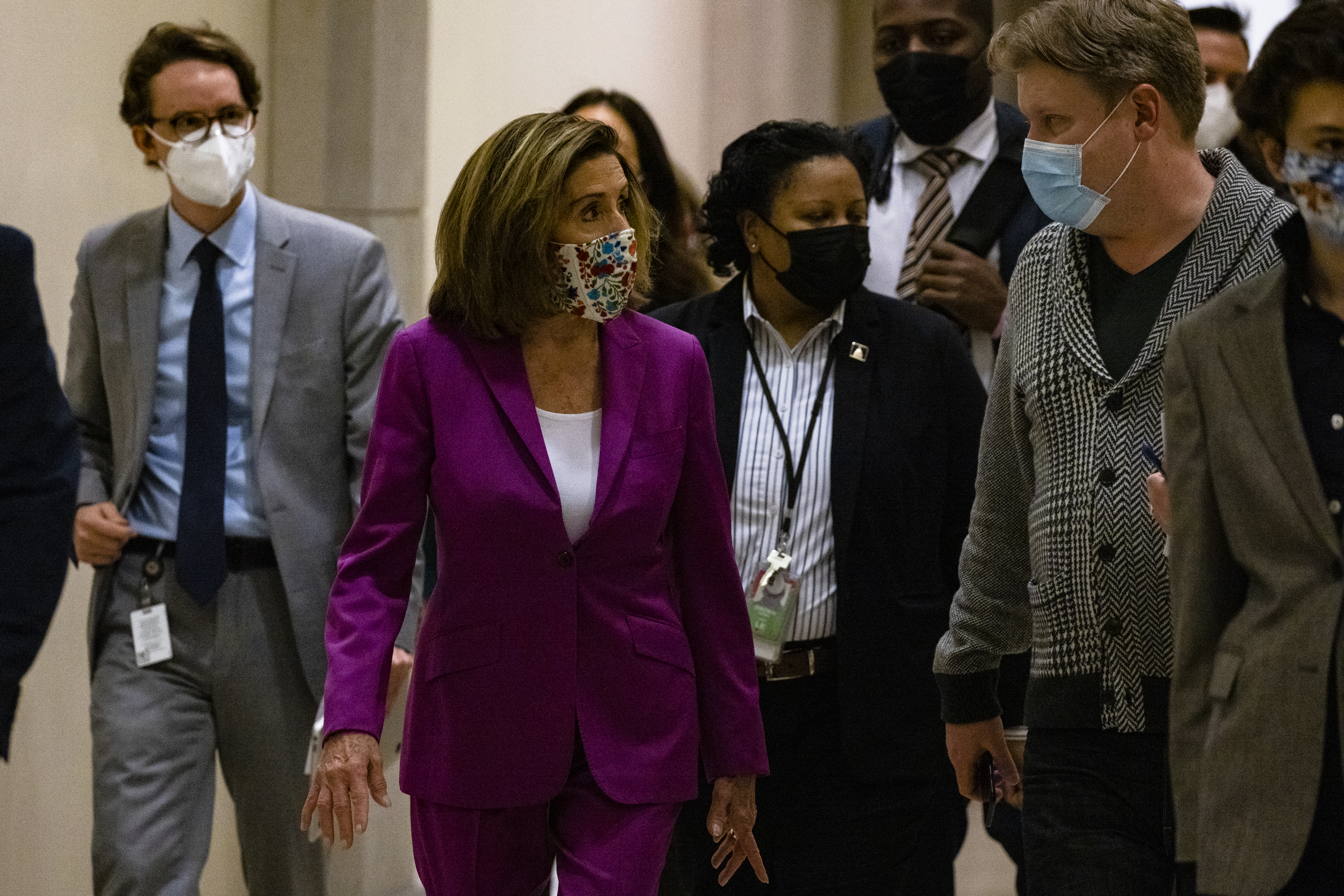 WASHINGTON, DC - JANUARY 07: Speaker of the House Nancy Pelosi heads back to her office after calling for the removal of President Donald Trump from office either by invocation of the 25th Amendment by Vice President Mike Pence and a majority of the Cabinet members or Impeachment at the U.S. Capitol on January 7, 2021 in Washington, DC. Following a rally yesterday with President Trump on the National Mall, a pro-Trump mob stormed and broke into the U.S. Capitol building causing the Joint Session of Congress to delay the certification of President-elect Joe Biden's victory over President Trump. (Photo by Samuel Corum/Getty Images)