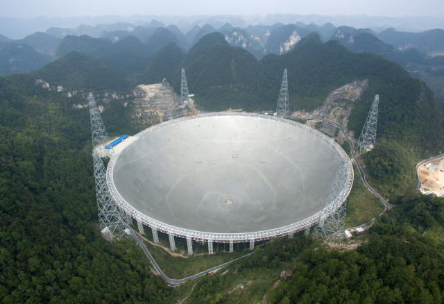 "The world's largest radio telescope named ""FAST"" is seen before being put into use on Sunday, in Pingtang county, Guizhou province, China, September 24, 2016. Picture taken September 24, 2016. China Daily/via REUTERS ATTENTION EDITORS - THIS IMAGE WAS PROVIDED BY A THIRD PARTY. EDITORIAL USE ONLY. CHINA OUT. NO COMMERCIAL OR EDITORIAL SALES IN CHINA.     - S1BEUDMCLPAA"