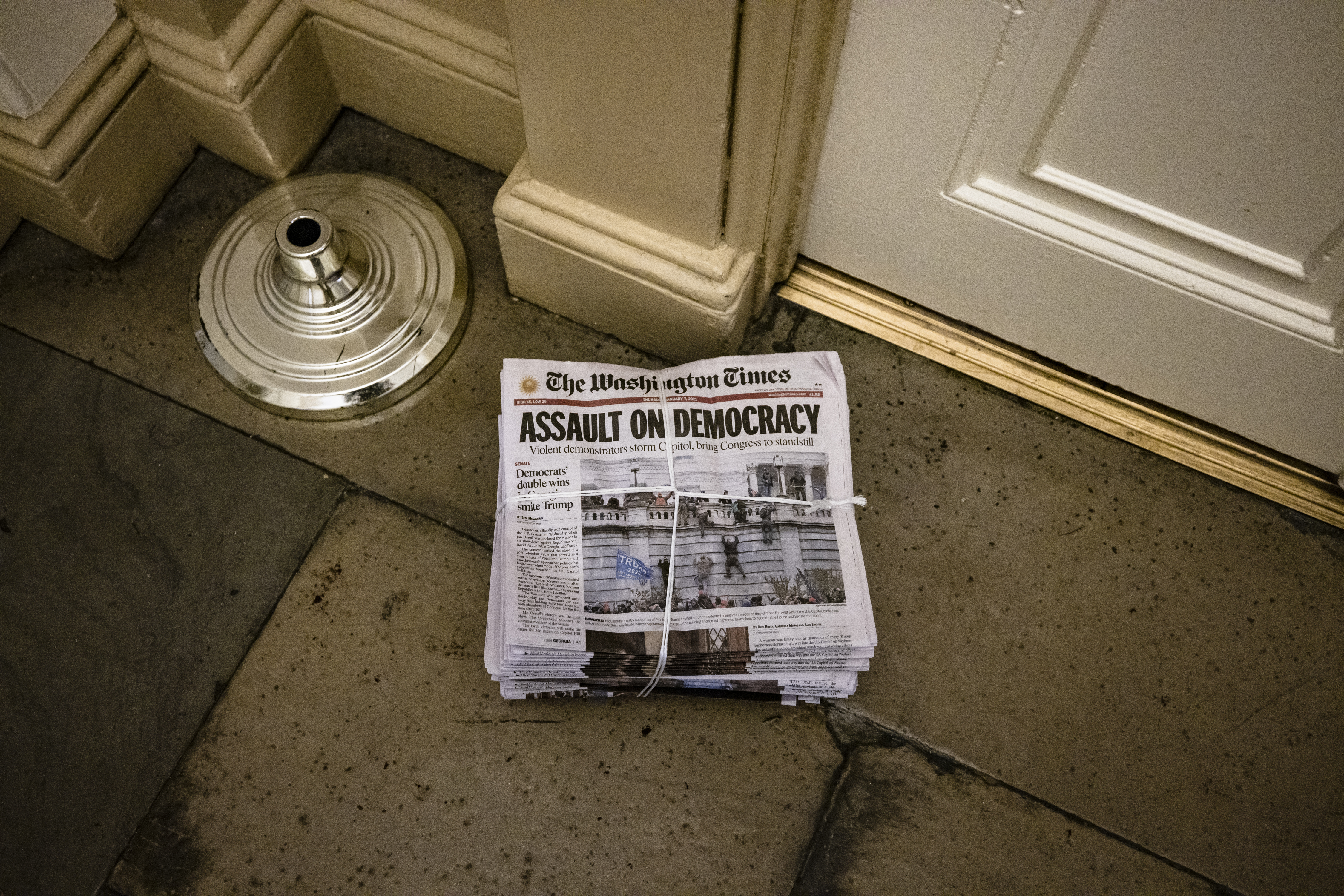 WASHINGTON, DC - JANUARY 07: A stack of today's edition of The Washington Times is left outside of an office in the U.S. Capitol building on January 7, 2021 in Washington, DC. Following a rally yesterday with President Donald Trump on the National Mall, a pro-Trump mob stormed and broke into the U.S. Capitol building causing a Joint Session of Congress to delay the certification of President-elect Joe Biden's victory over President Trump. (Photo by Samuel Corum/Getty Images)